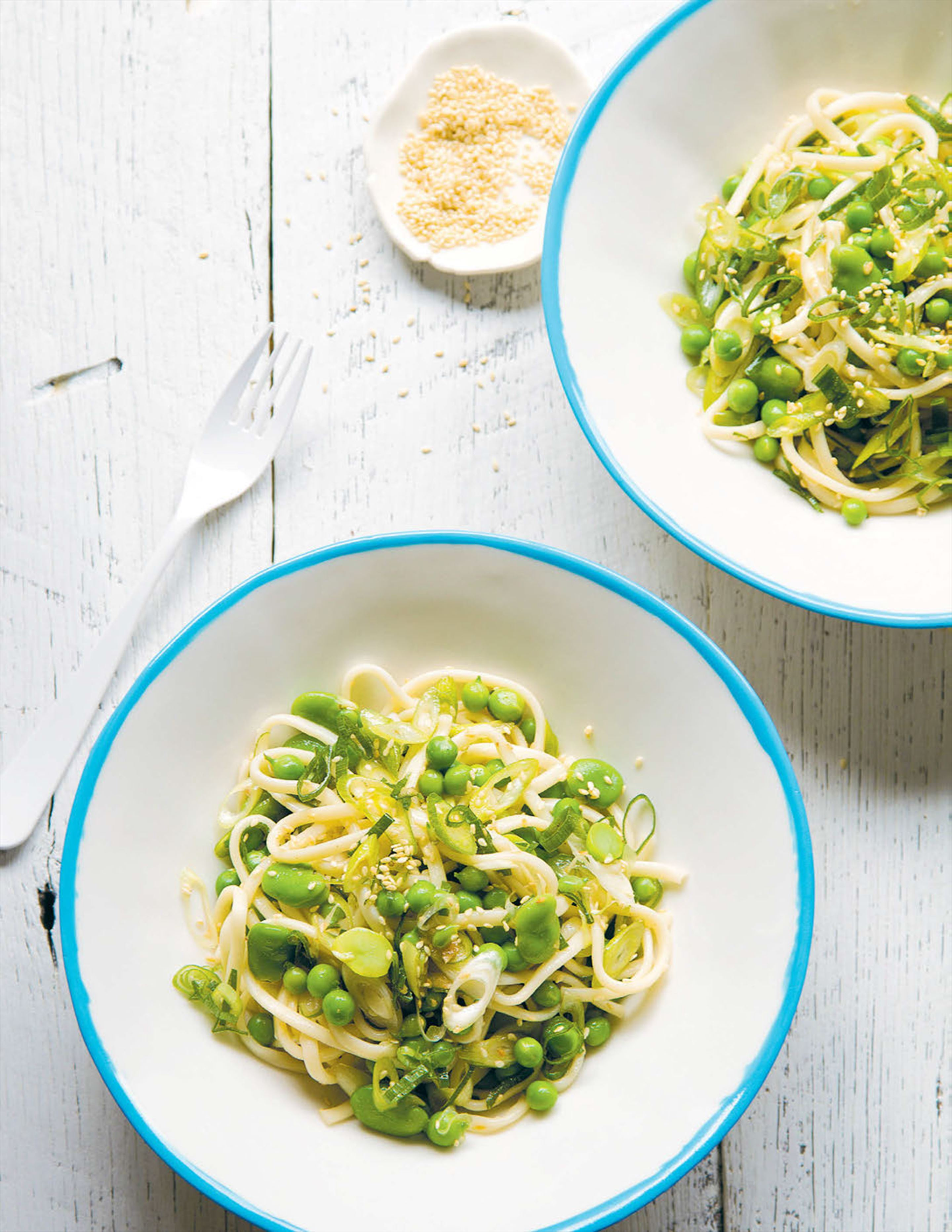 Noodles with broad beans, peas and spicy lemon dressing