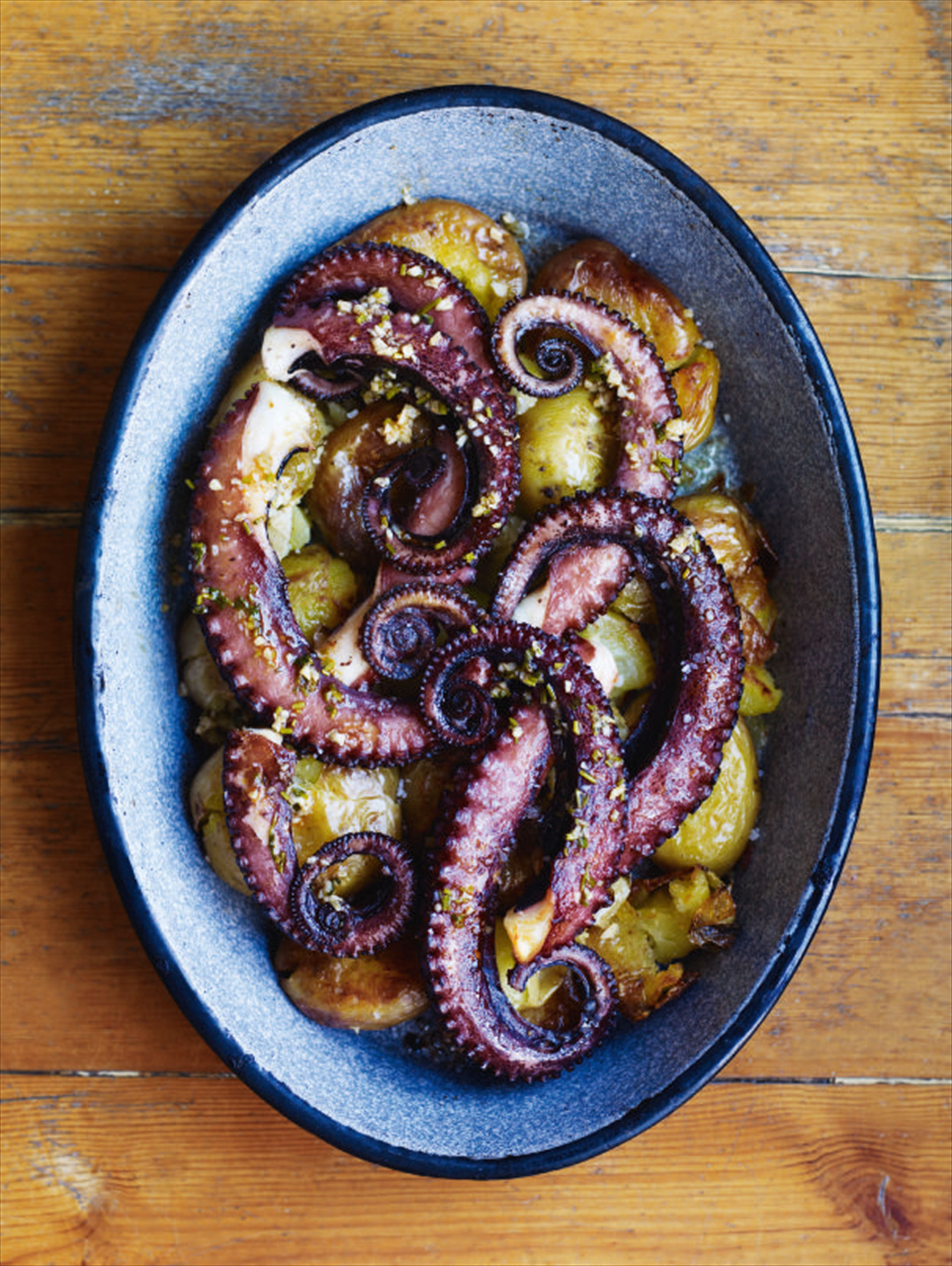 Octopus with smashed potatoes, olive oil and piso
