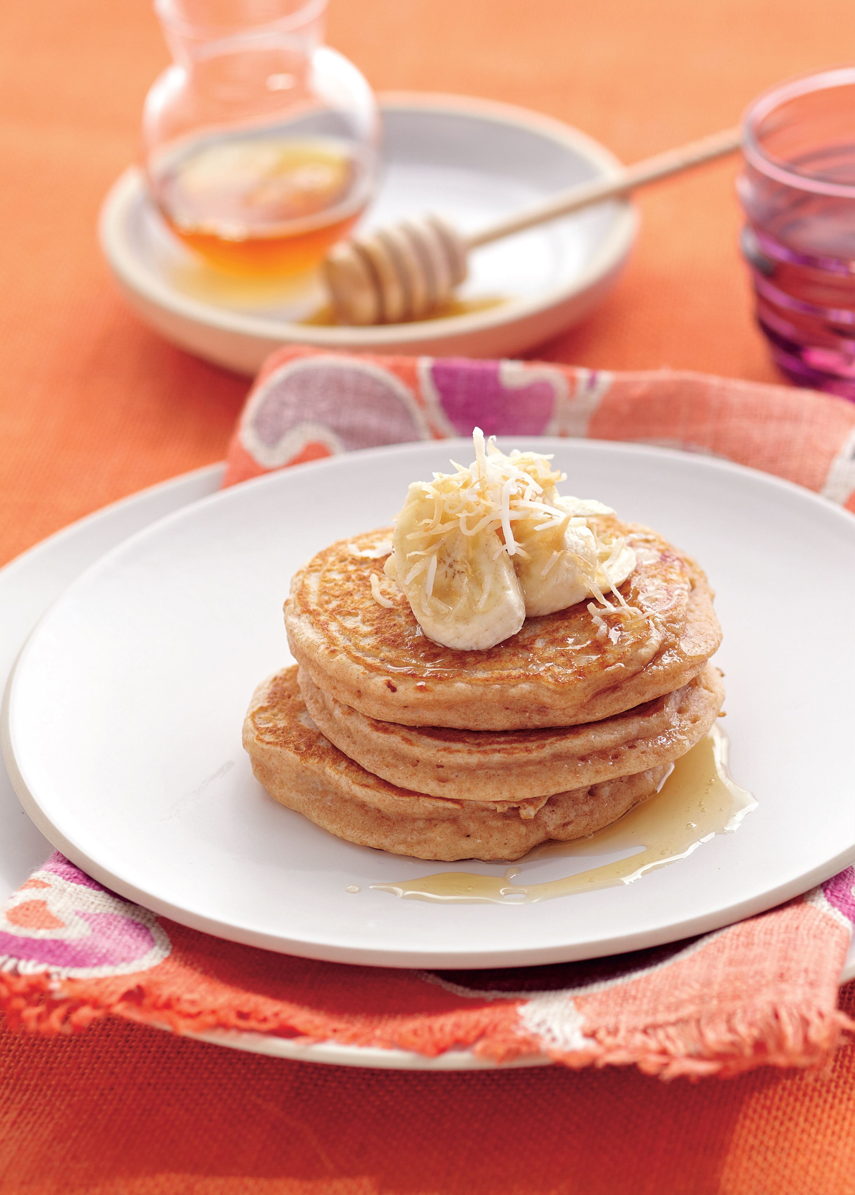 Spelt pancakes with yoghurt, honey and toasted coconut