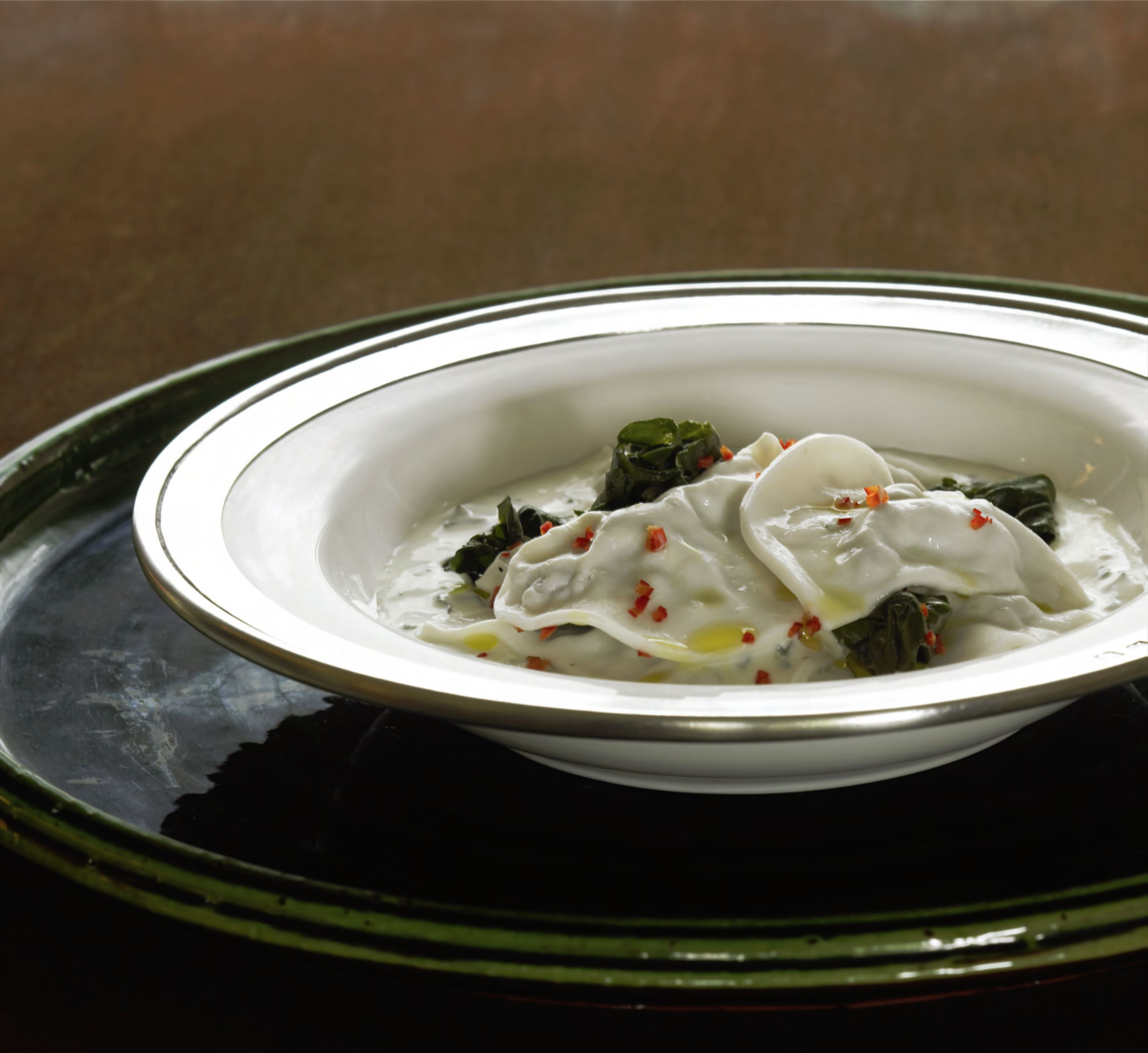 Chiche barak Lebanese-style dumplings in yoghurt soup with silverbeet