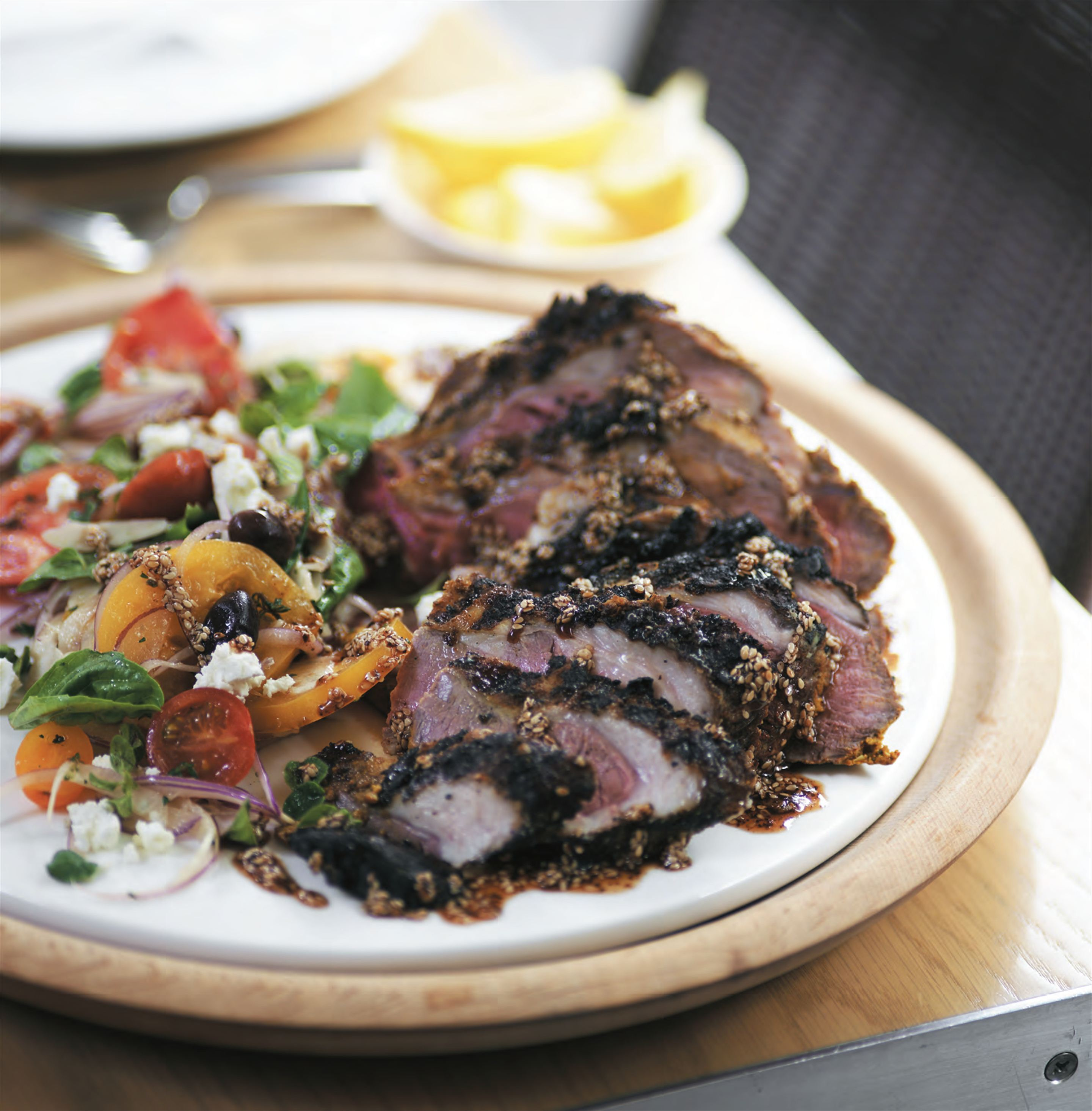 Barbecued butterflied leg of lamb with Lebanese tomato salad