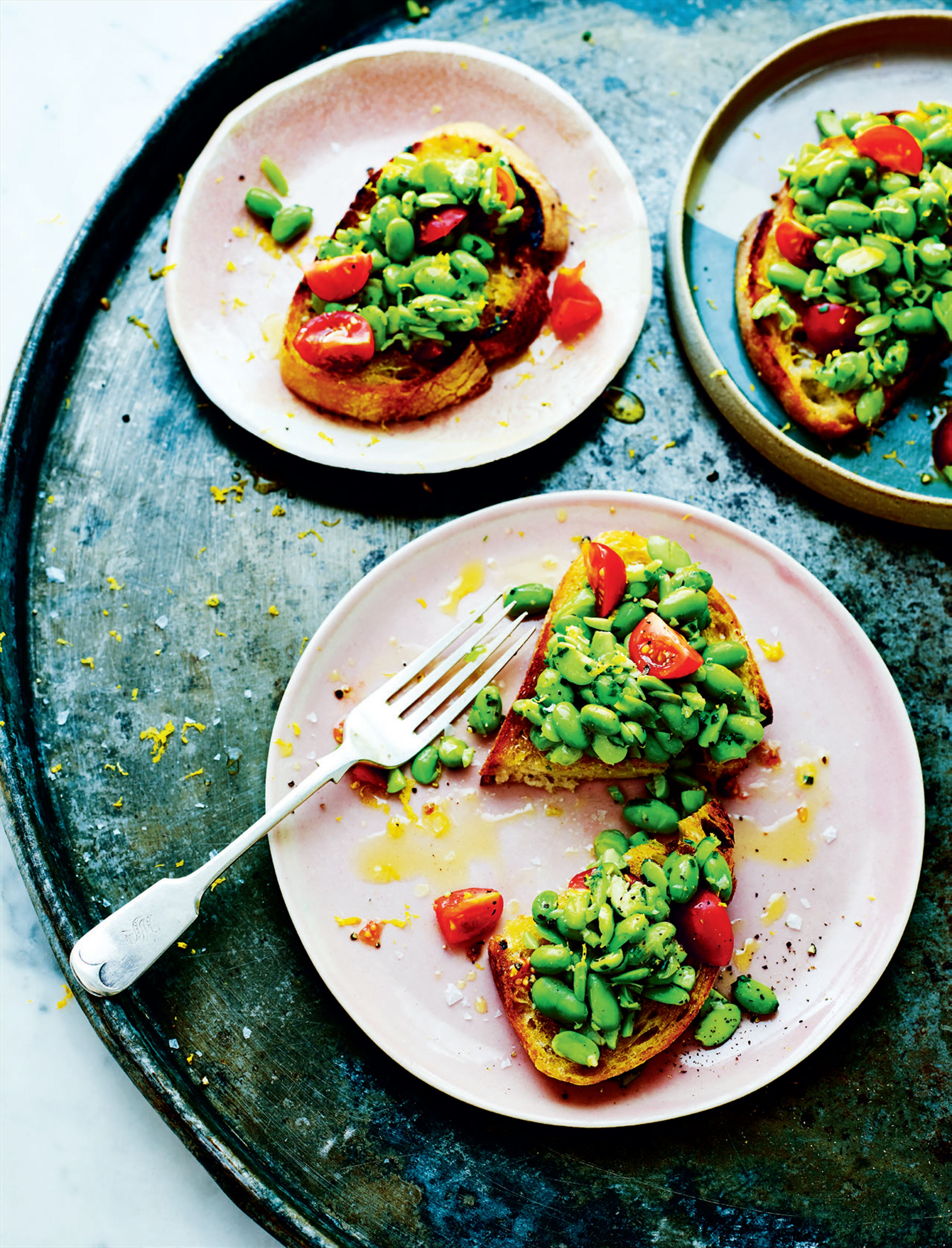 Edamame beans on toast with lemon and chives
