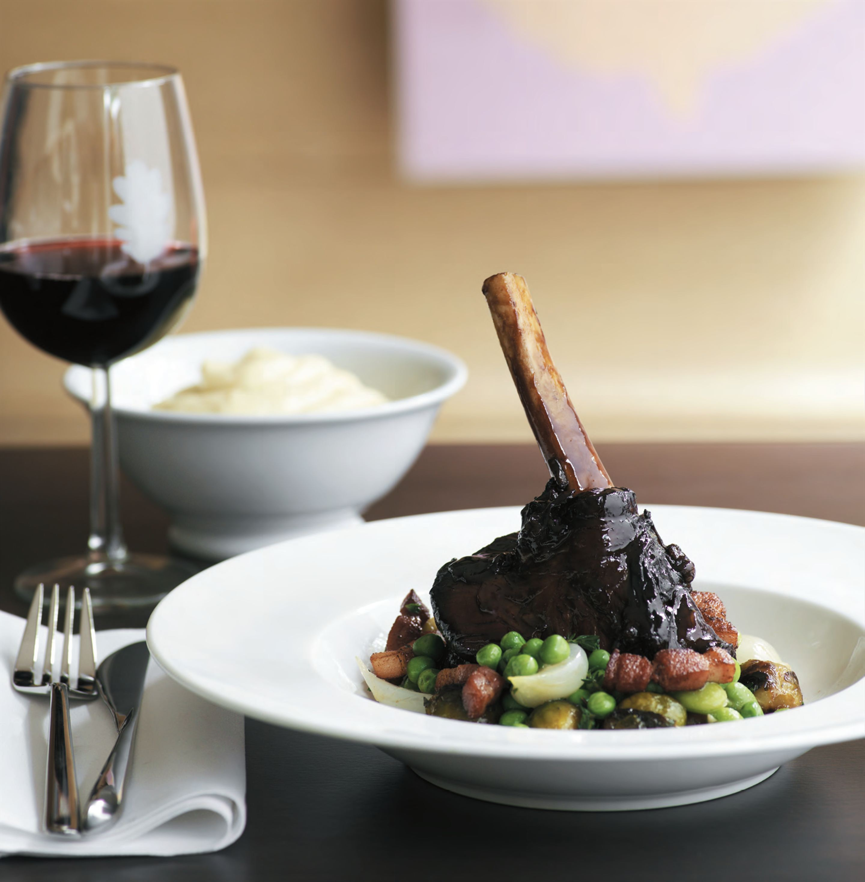 Lamb shanks marinated in the style of venison with chestnuts, smoked bacon and celeriac