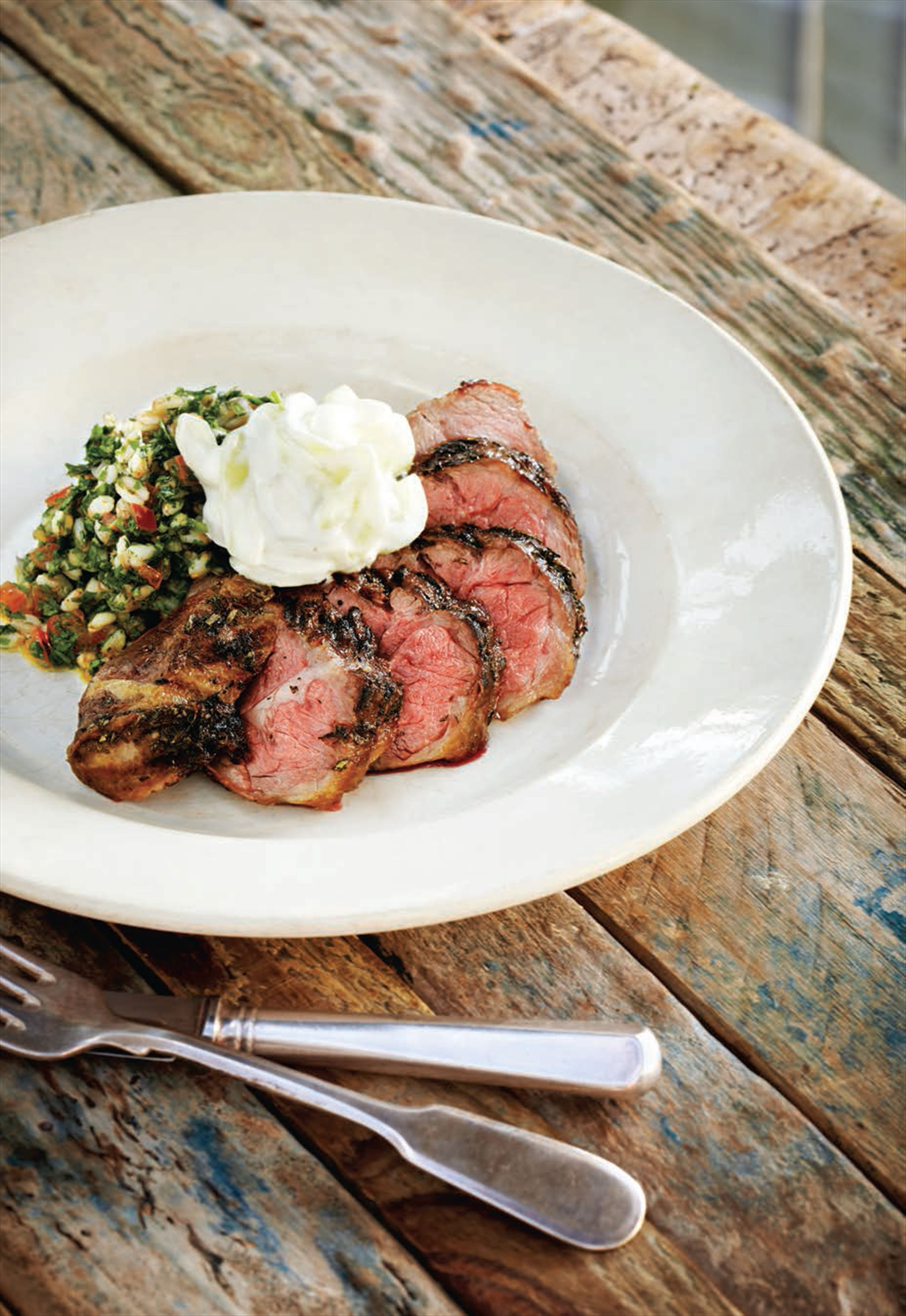 Barbecued fillet of lamb neck with a spelt, lemon and herb salad and cucumber yoghurt