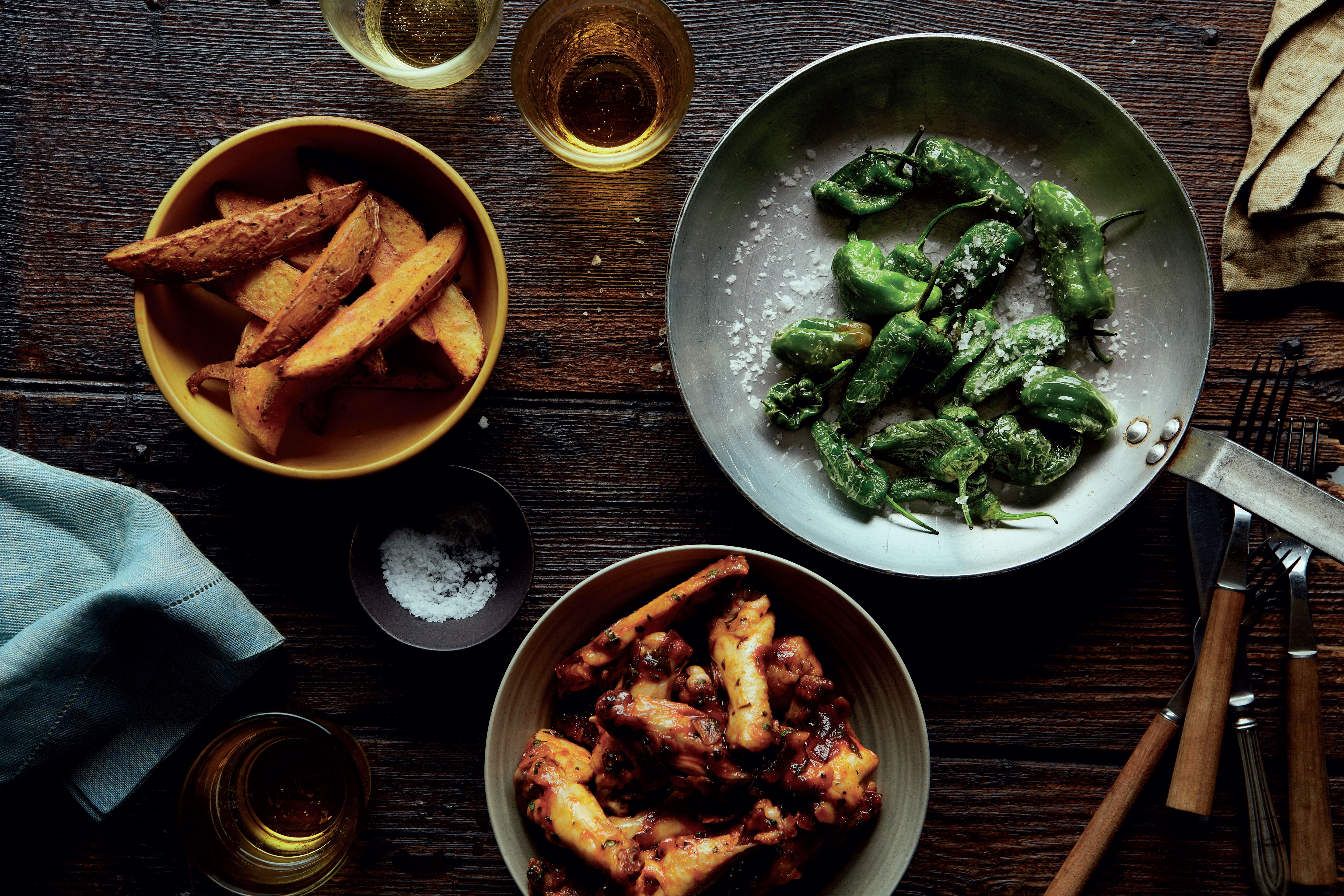 Smoky chilli chicken wings, spiced potato wedges and padrón peppers