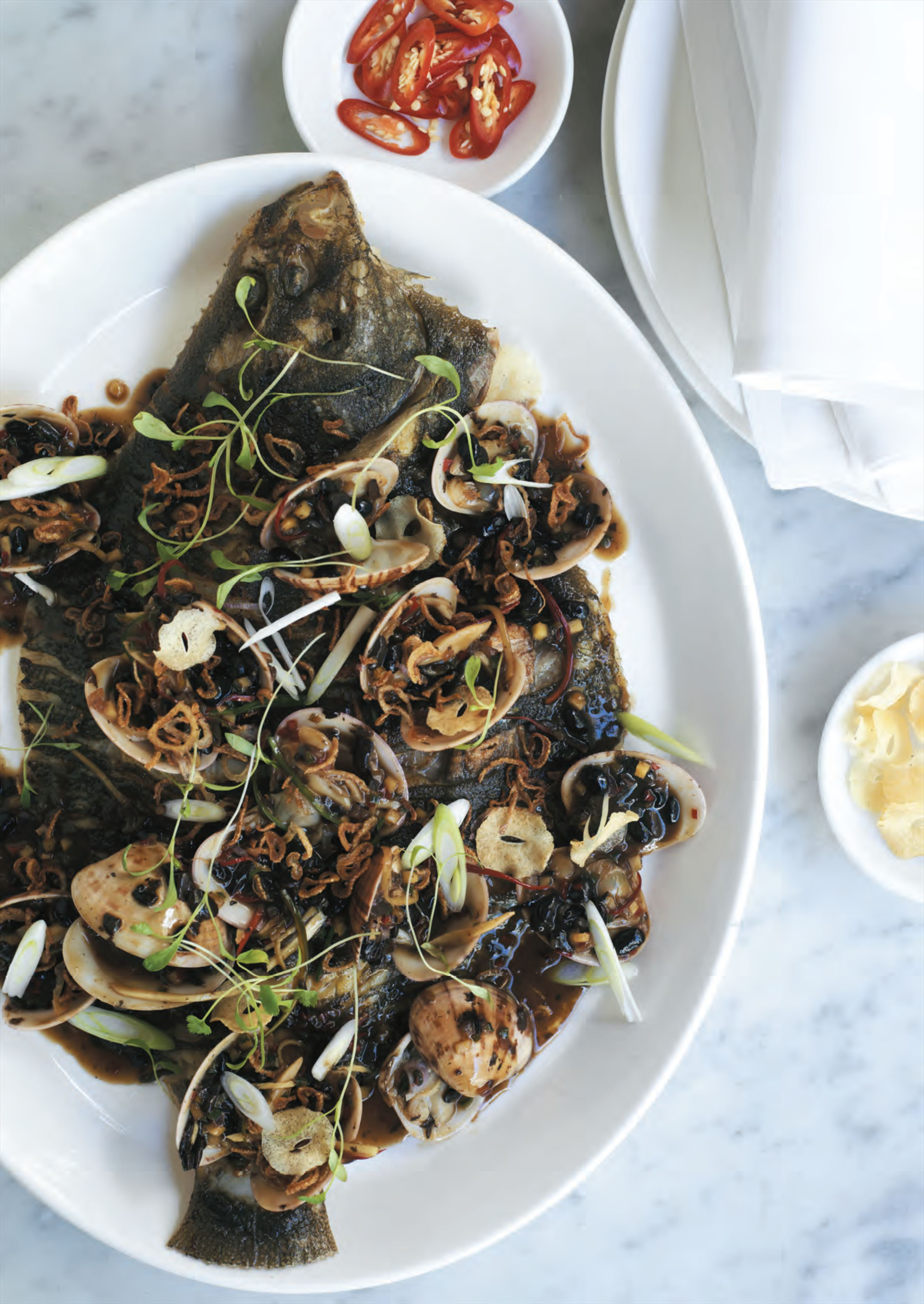 Whole roasted flounder with pipis, black beans and crispy shallots