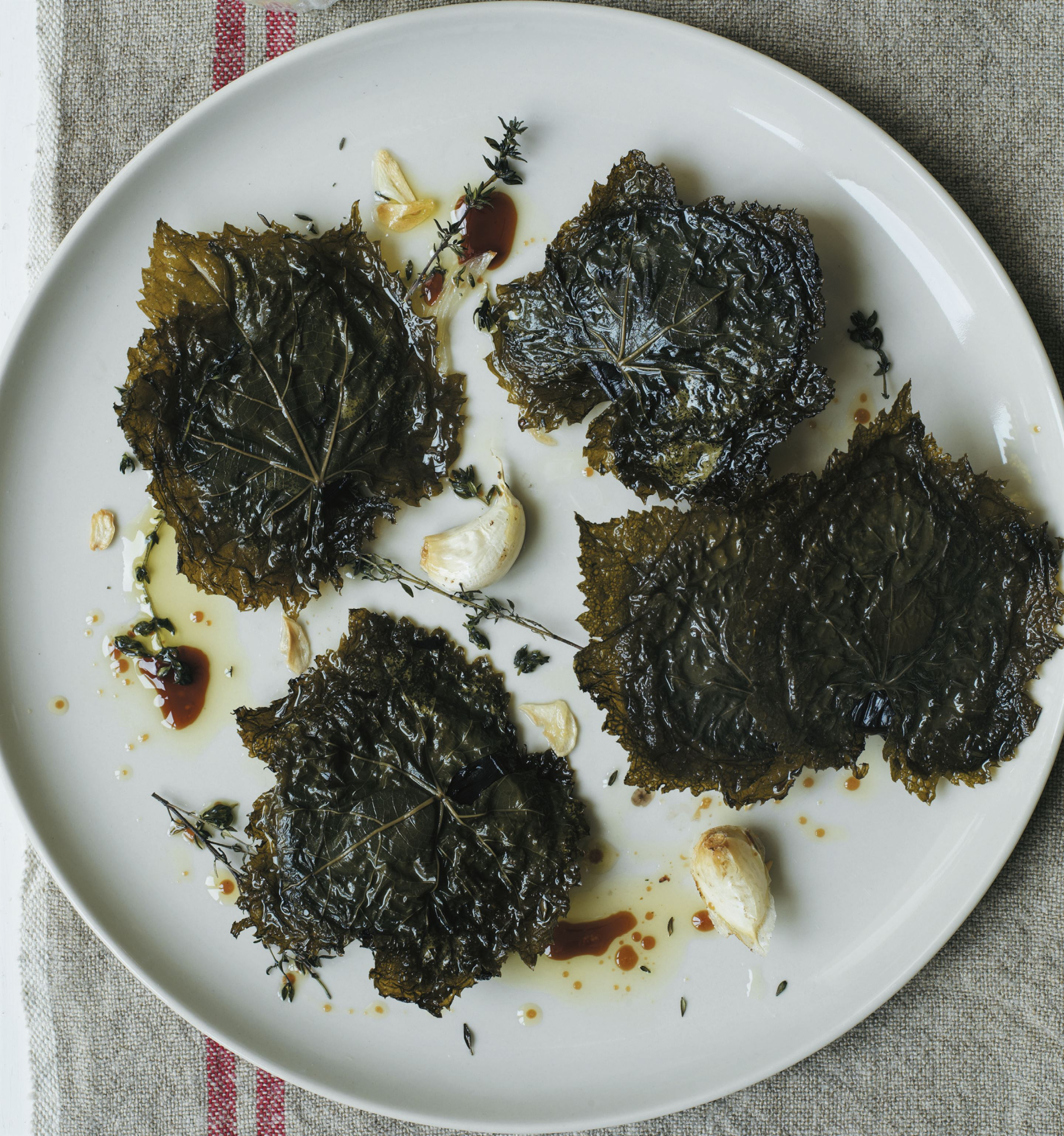 Portobello mushrooms baked between vine leaves