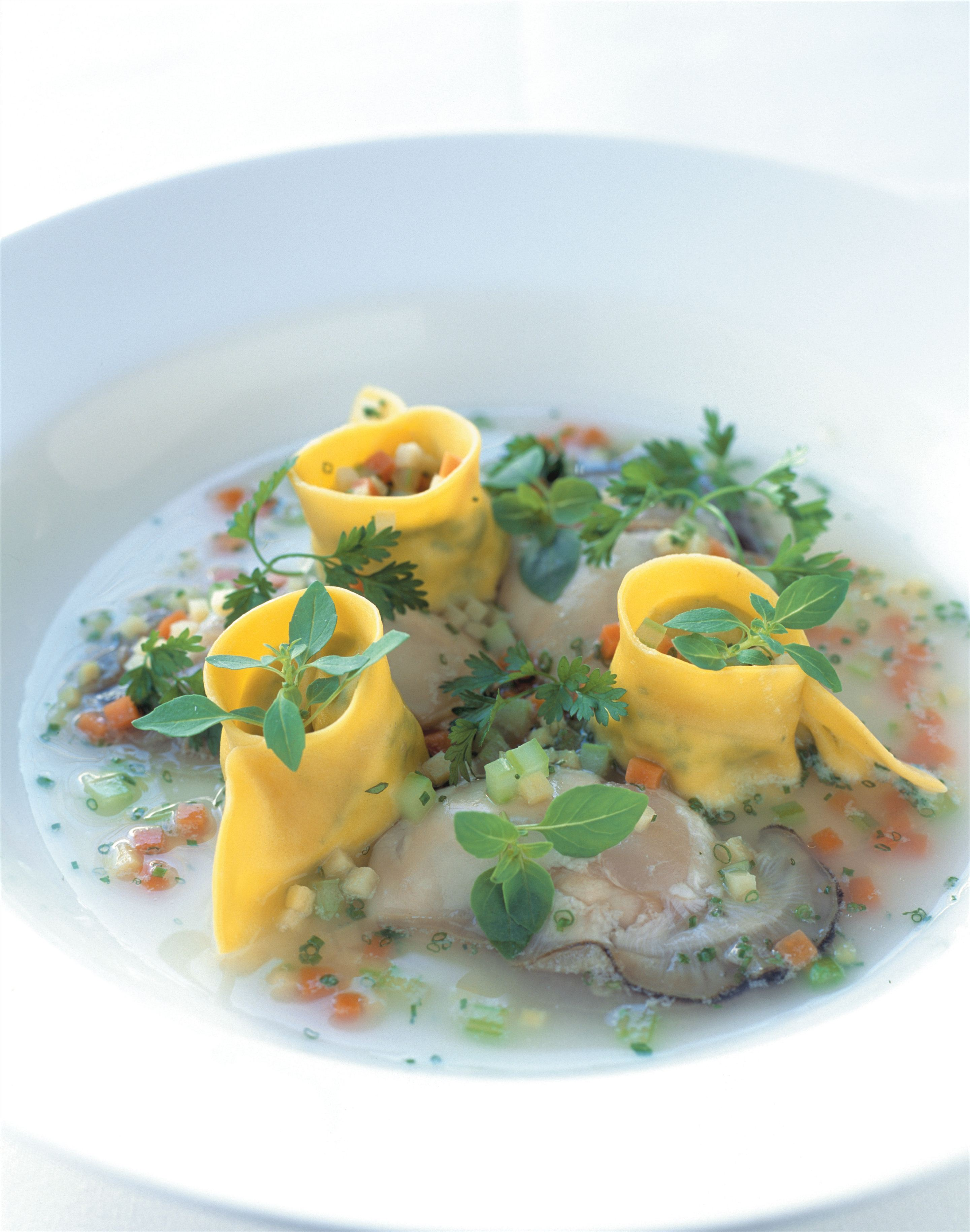 Nage of angasi oysters with scallop and ginger tortellini