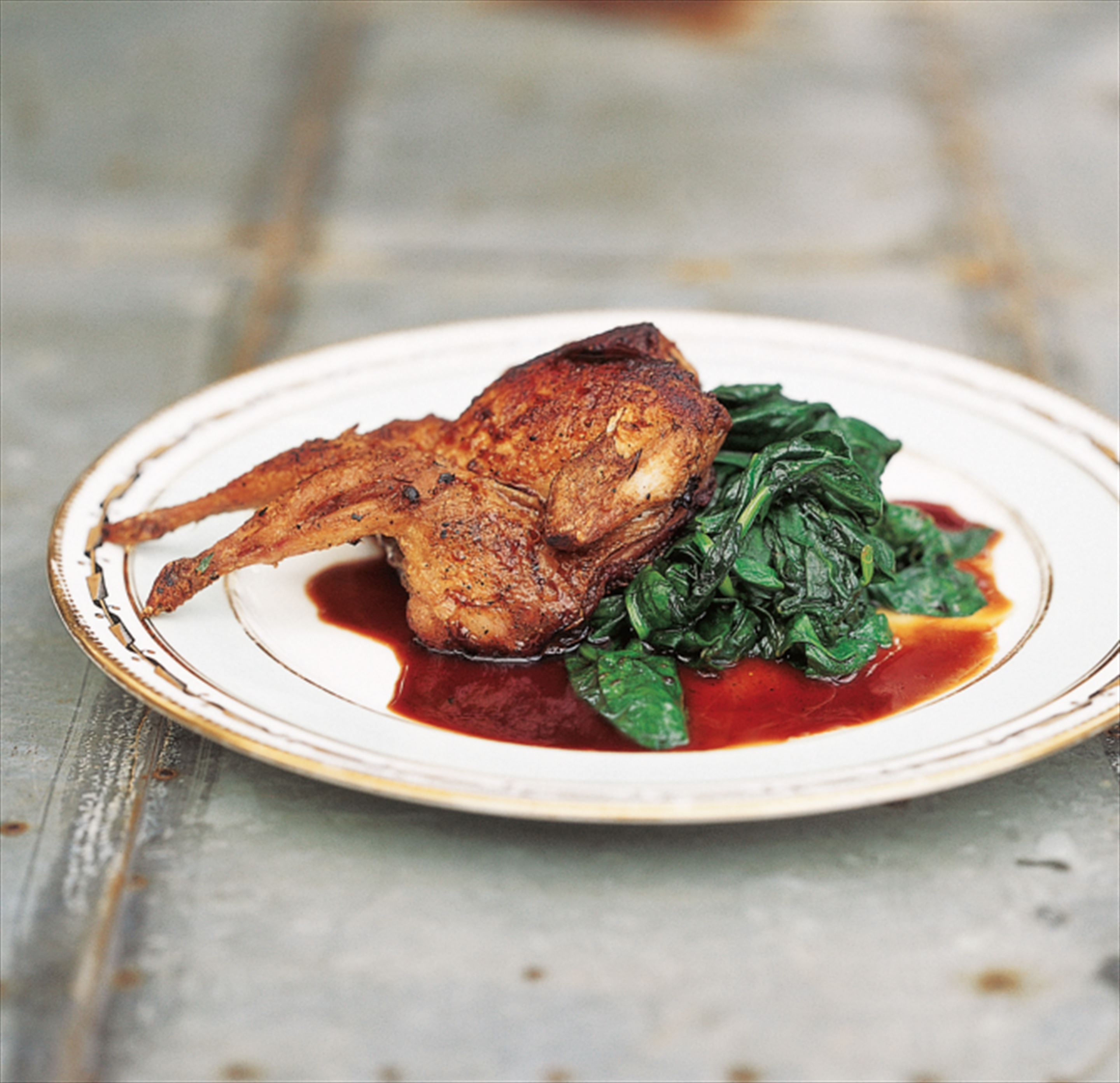 Tea-smoked quail with Chinese five spice and buttered spinach