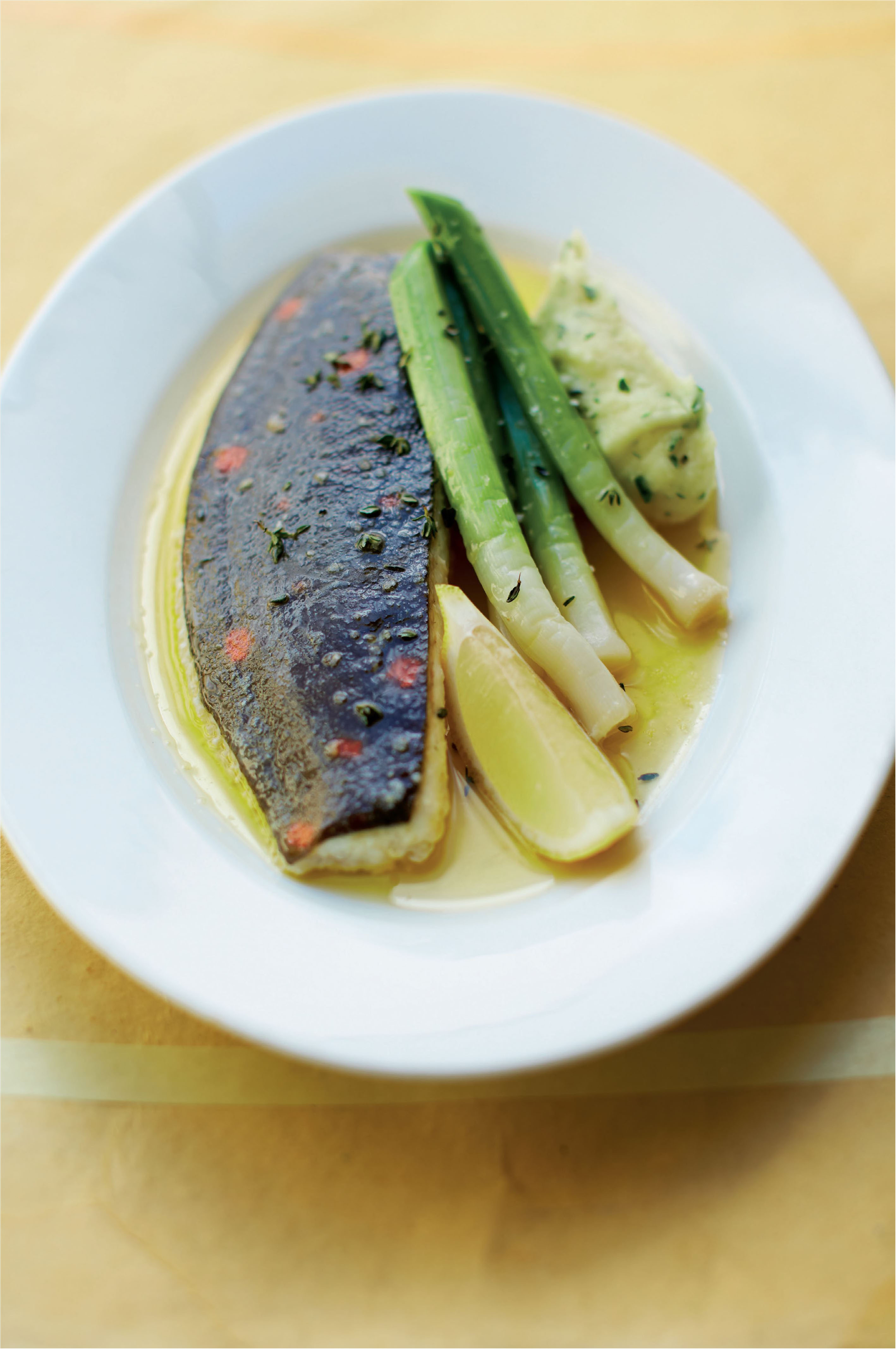 Plaice poached in butter with leeks, and parsley and mustard mash