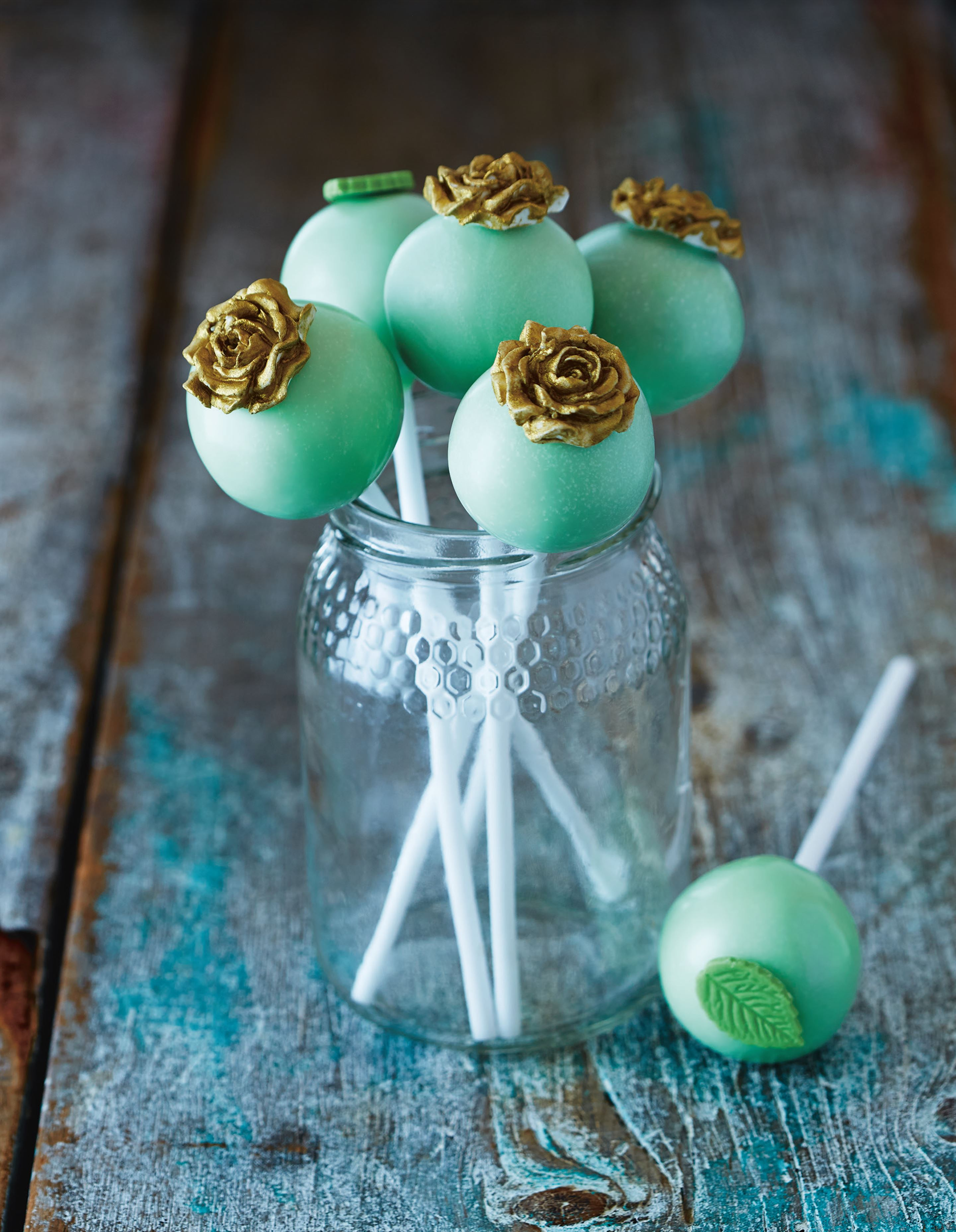 Rose- and leaf-topped cake pops