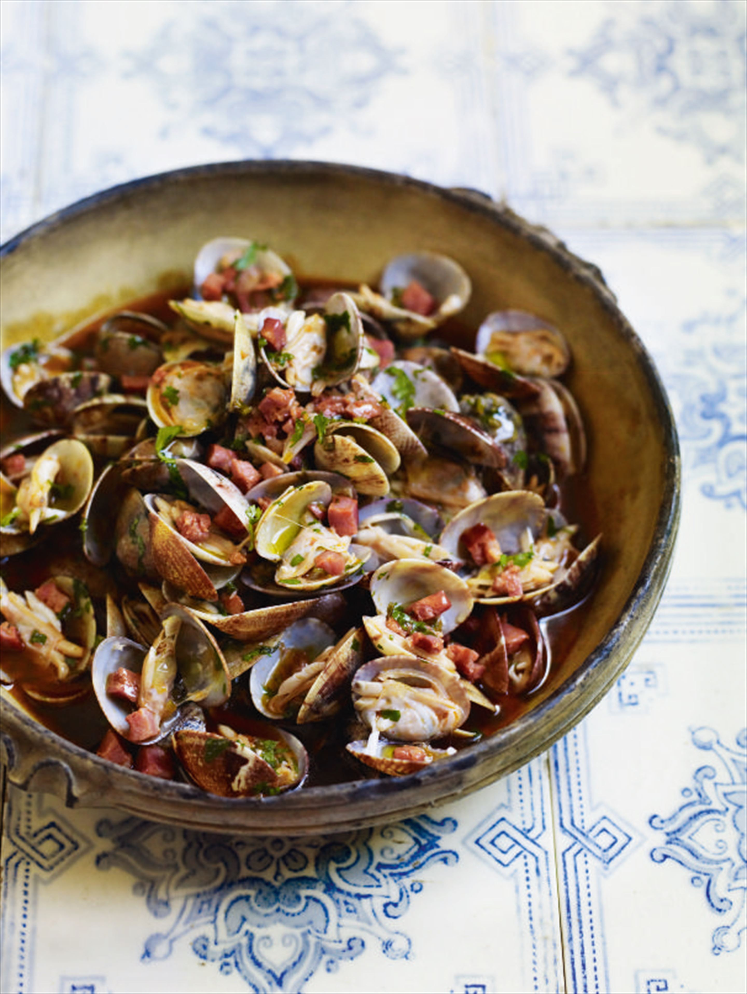 Clams with chouriço, garlic and coriander