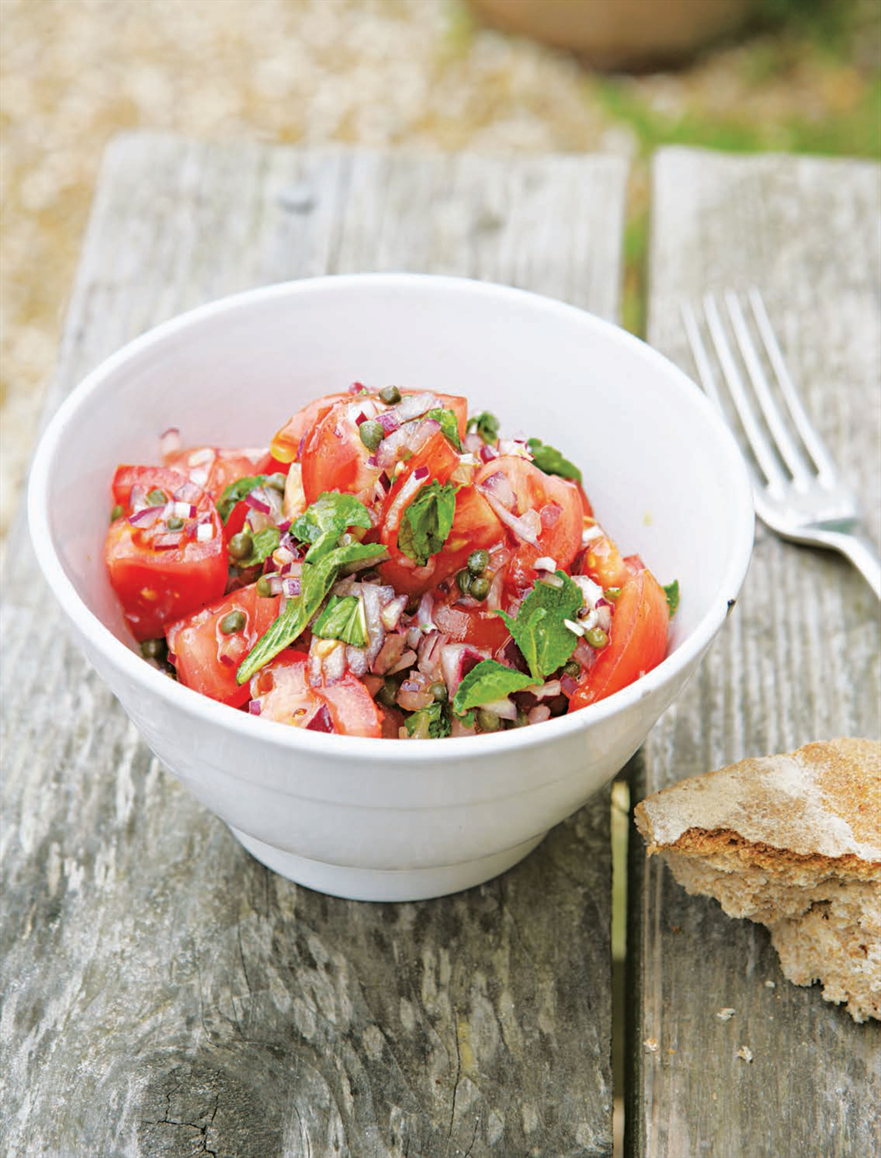 Tomato salsa salad with capers and mint