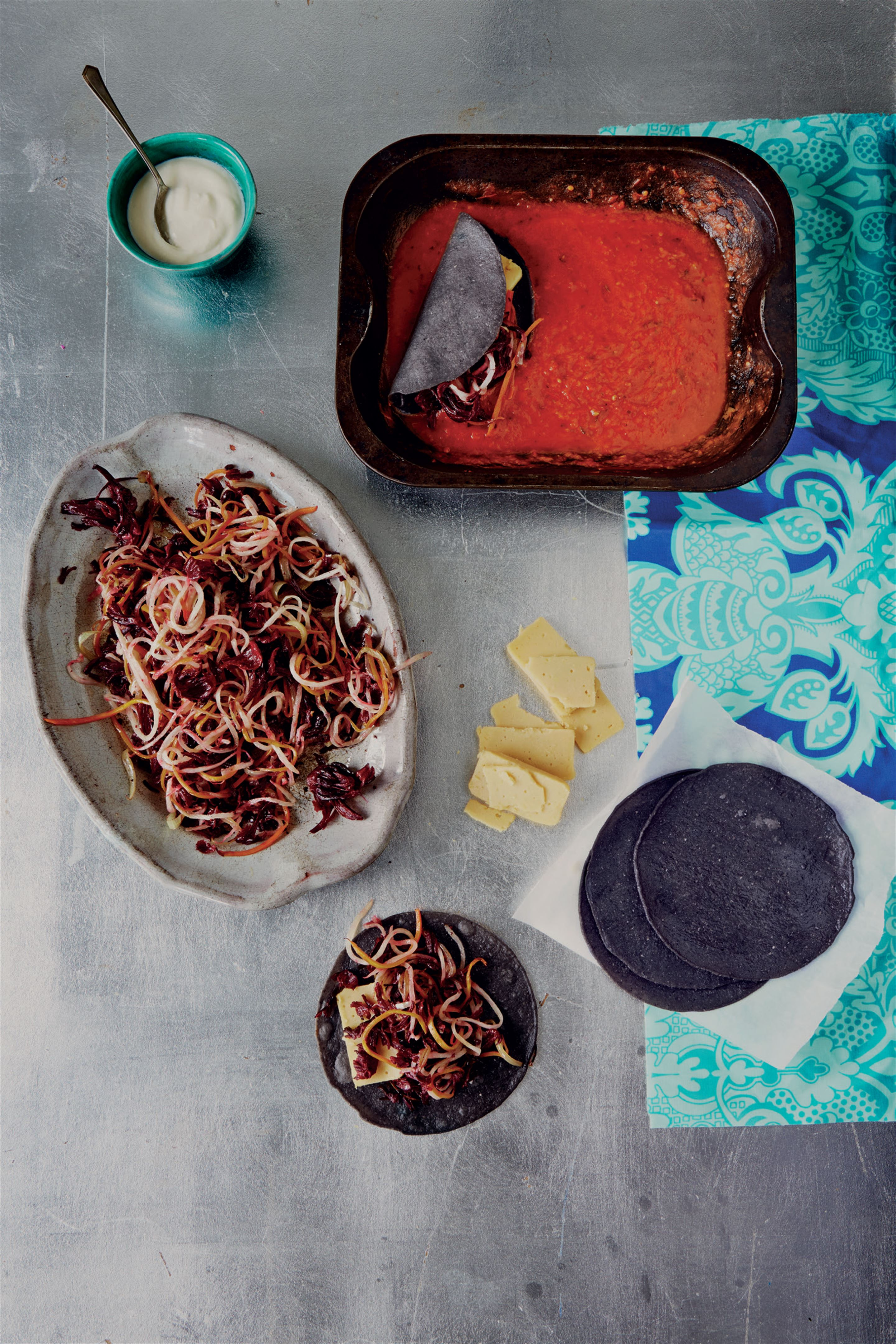 Hibiscus flowers in blue corn enchiladas with pickled purple cabbage