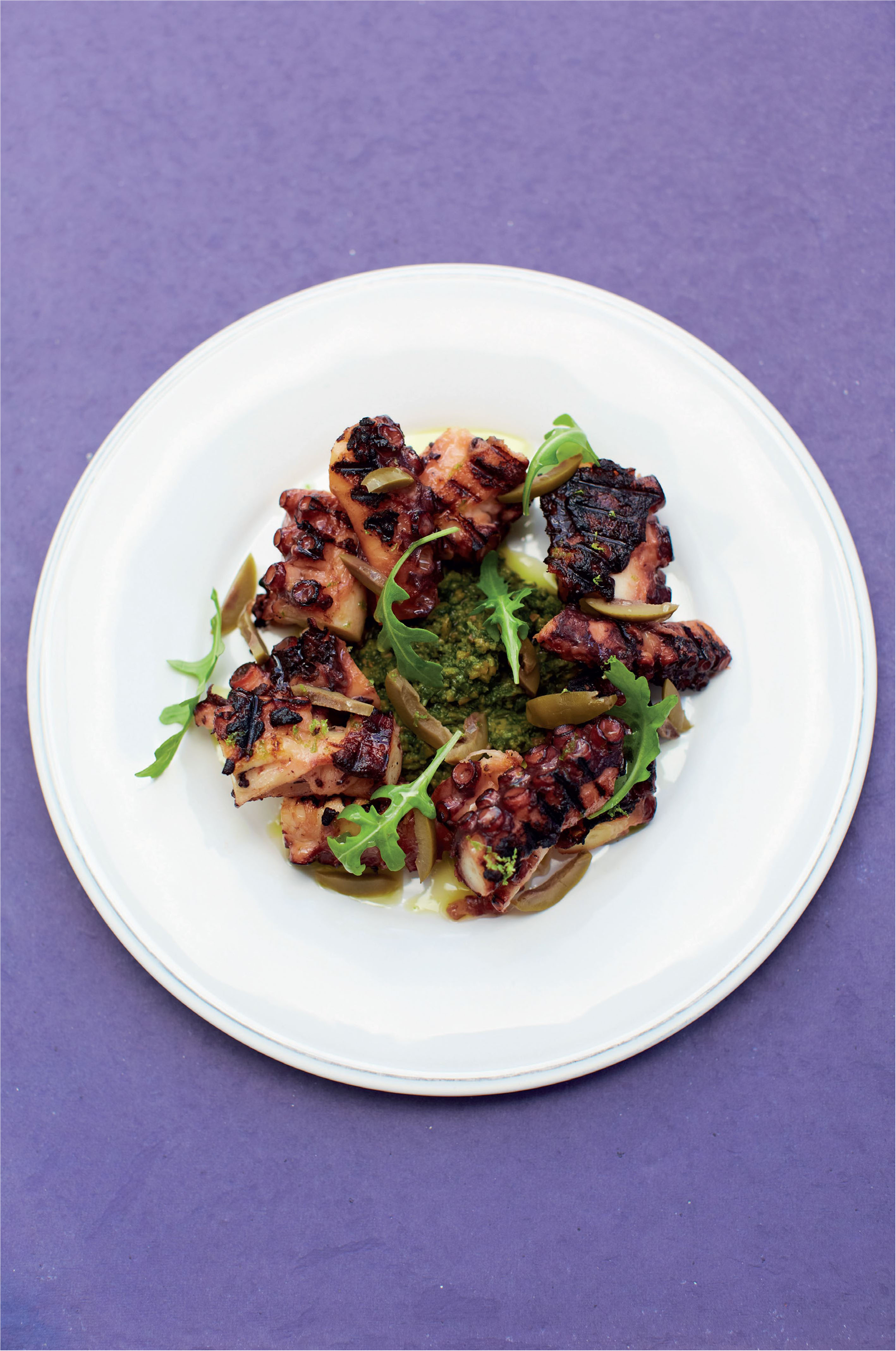 Braised octopus with lime, olive and rocket dressing