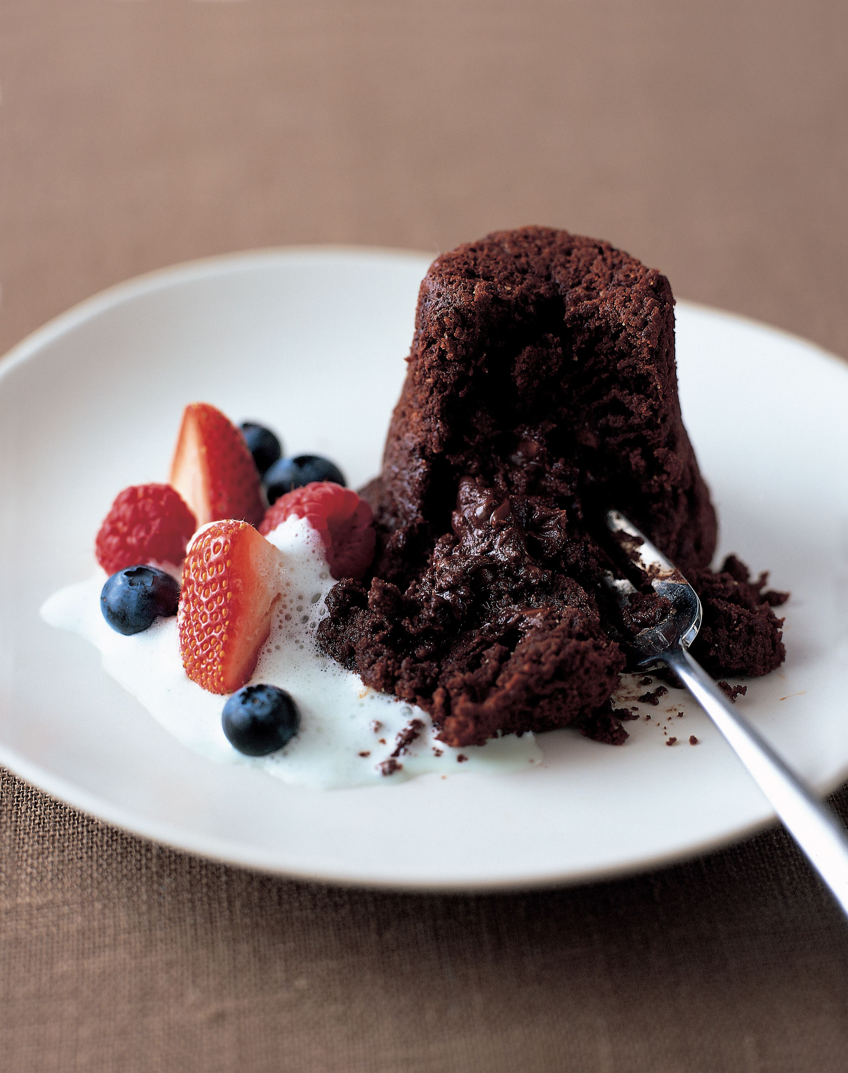 Hot chocolate fondants with summer berries and mint froth