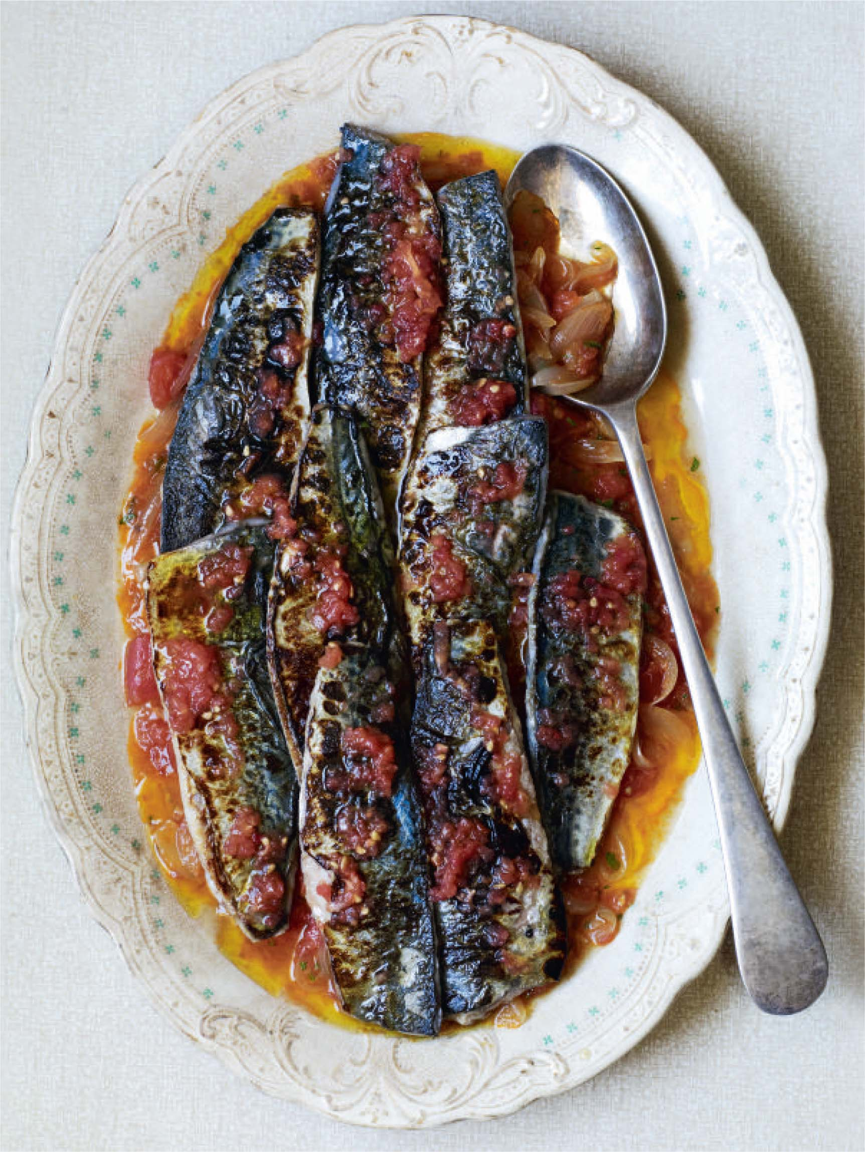 Grilled mackerel with melting tomatoes