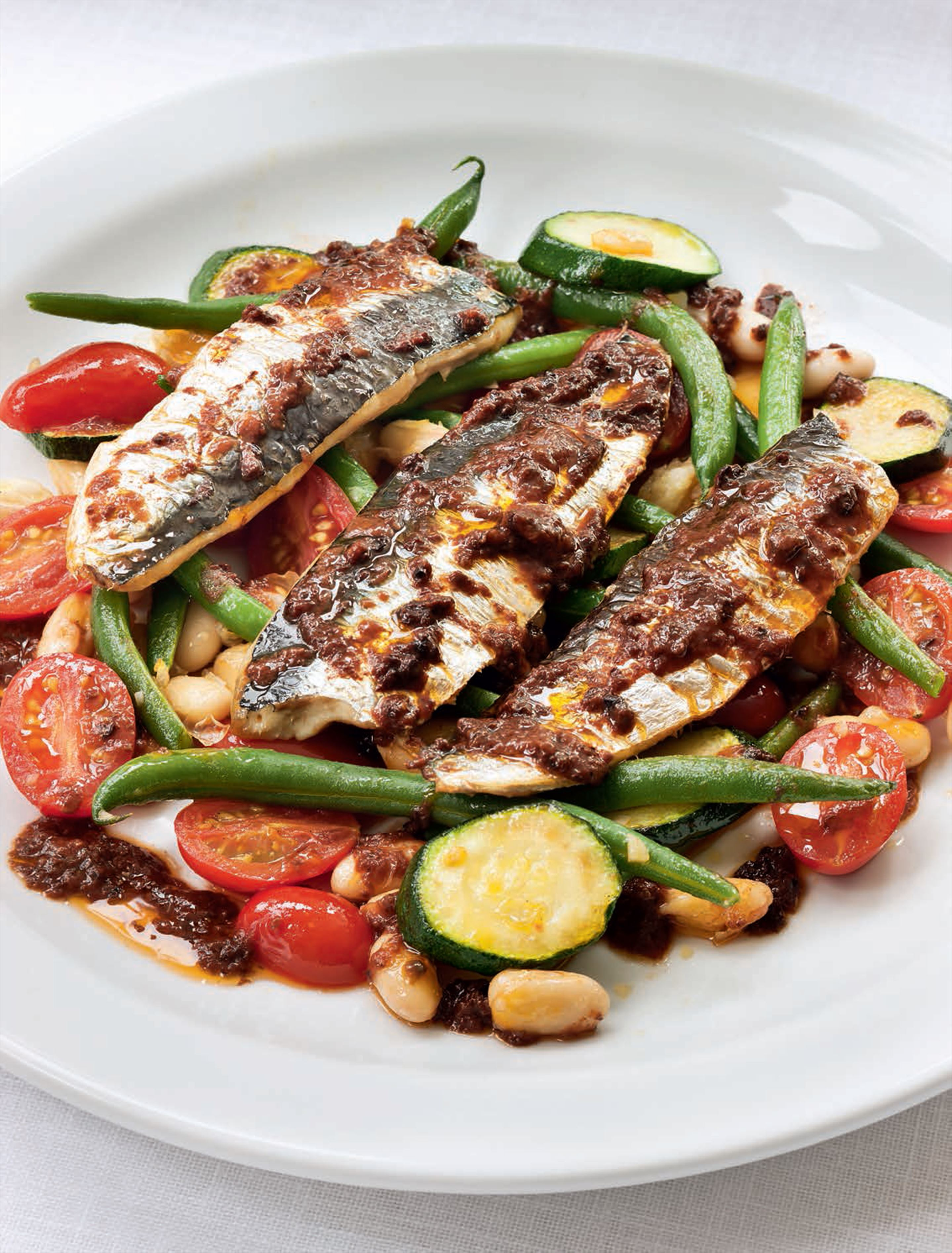 Grilled sardines with tomato tapenade sauce & beans
