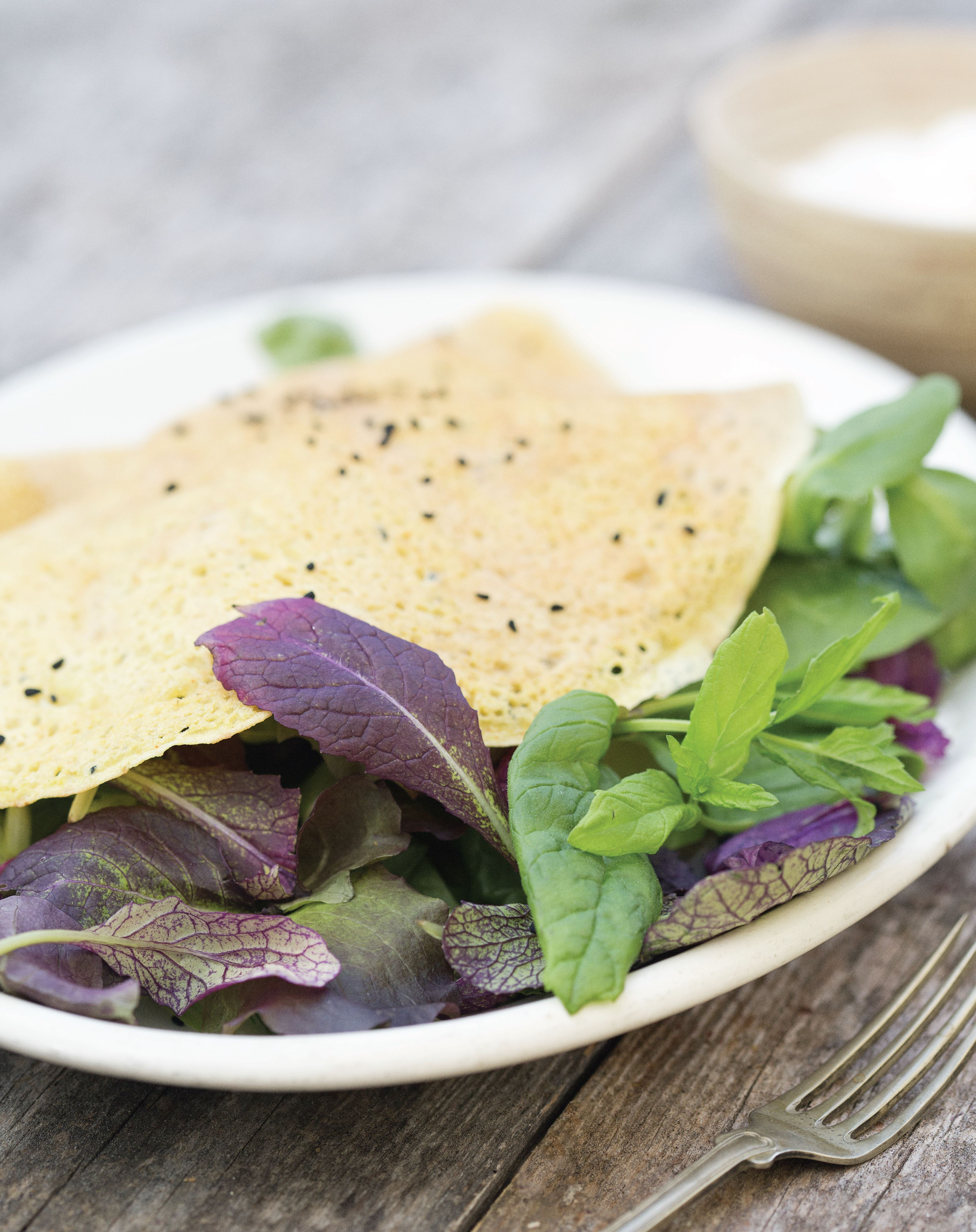 Indian chickpea crêpes with raita and leafy greens