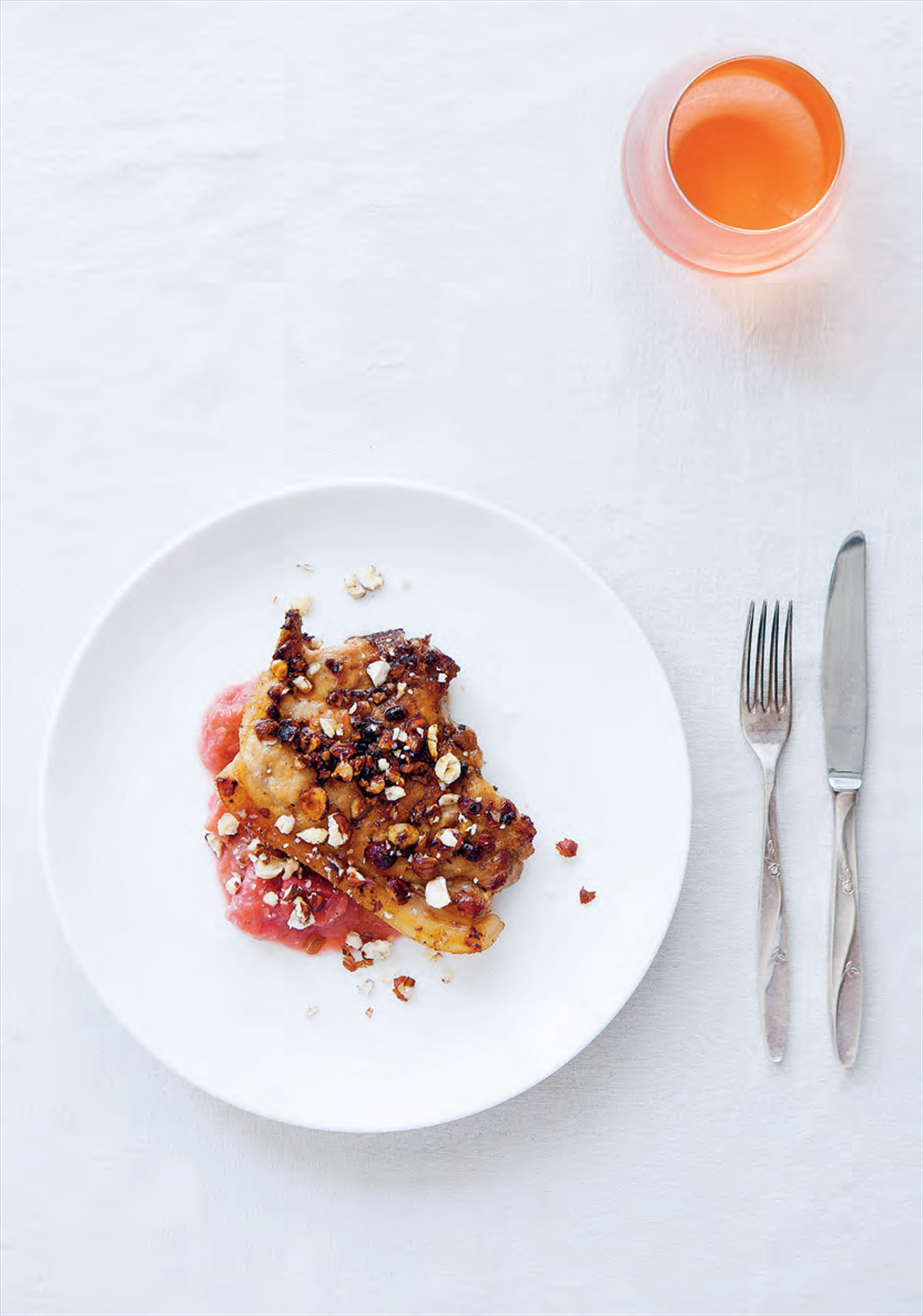 Pork chops with rhubarb, honey, ginger and hazelnuts