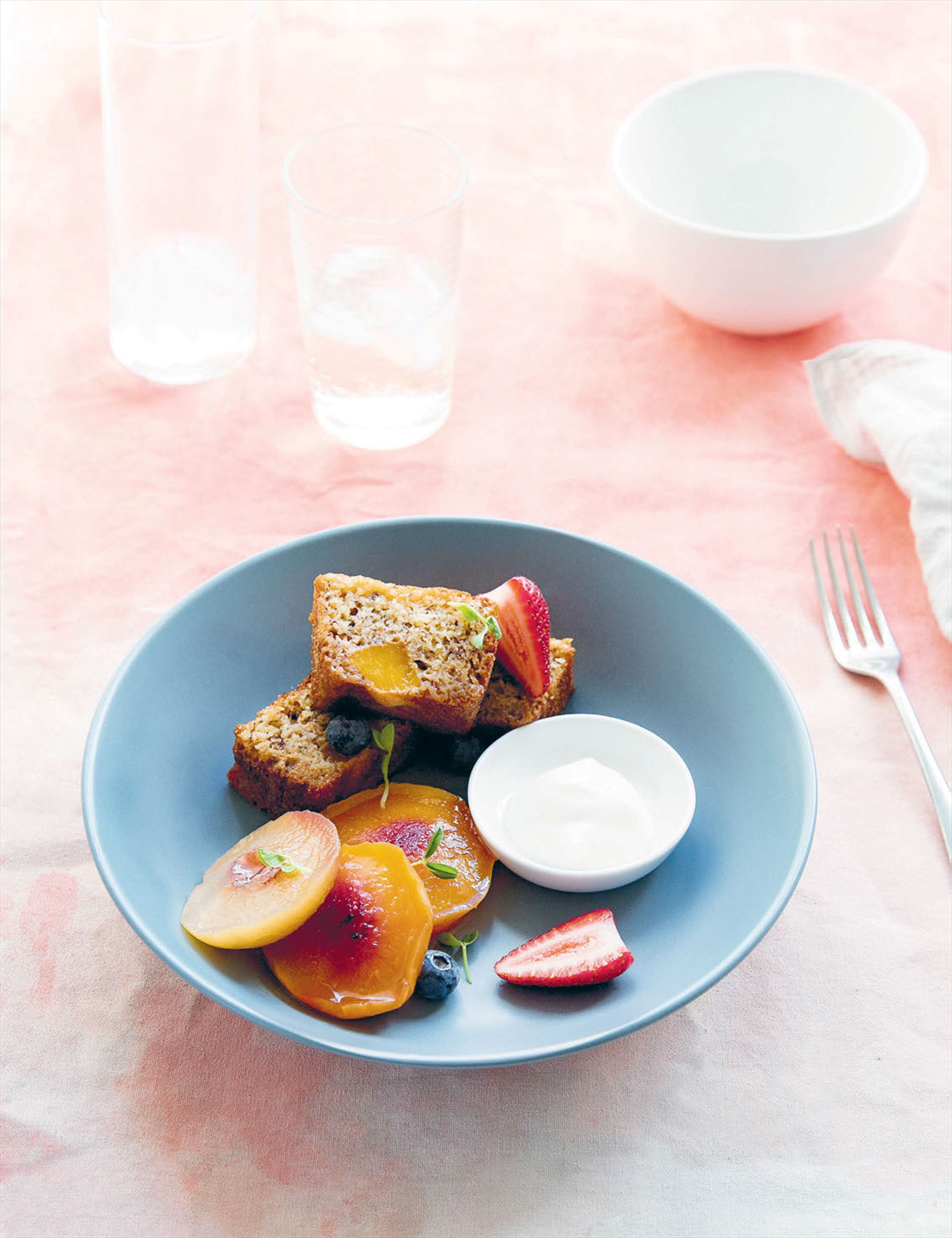 Mango and coconut bread with poached stone fruit