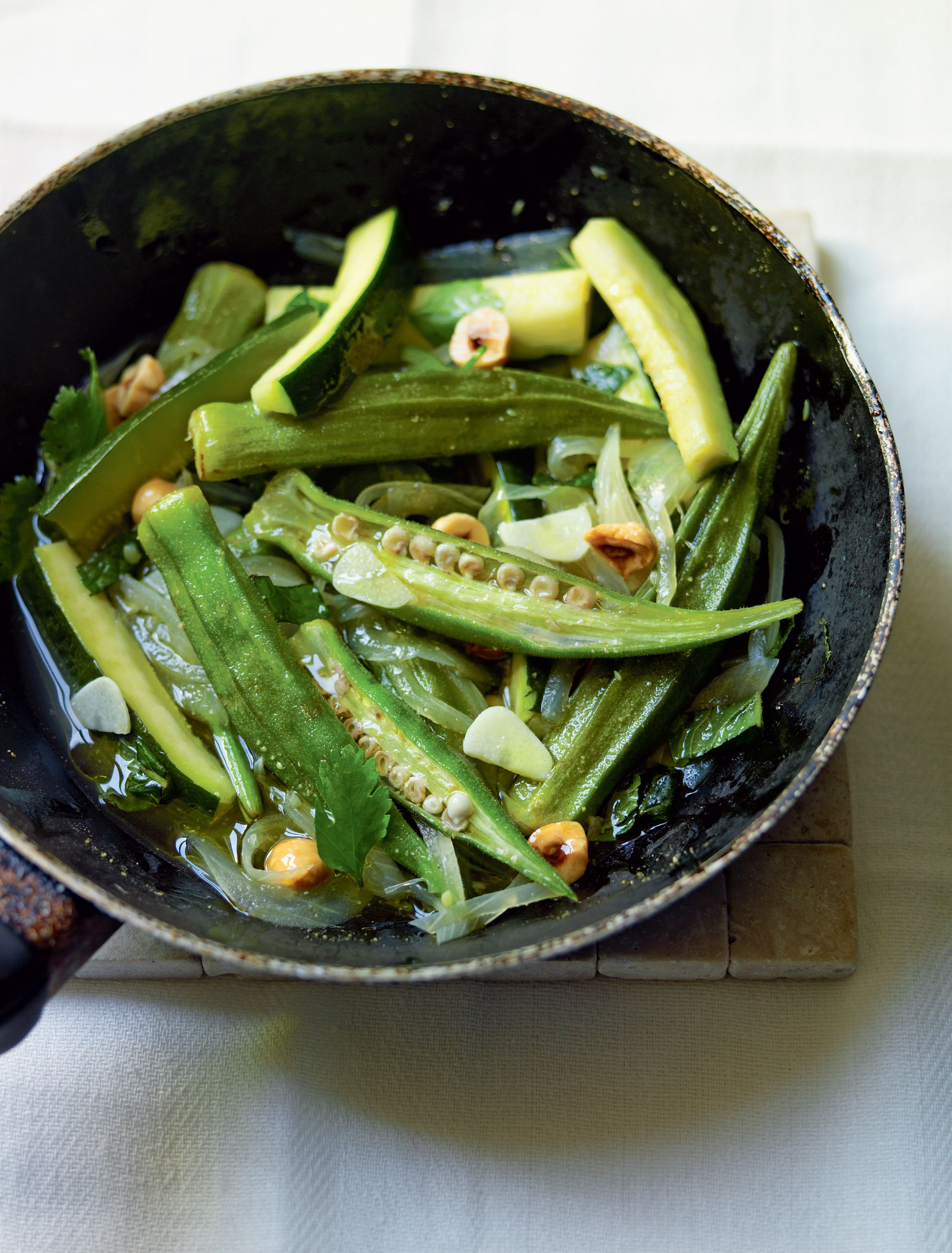 Zucchini, okra and roasted hazelnut braise