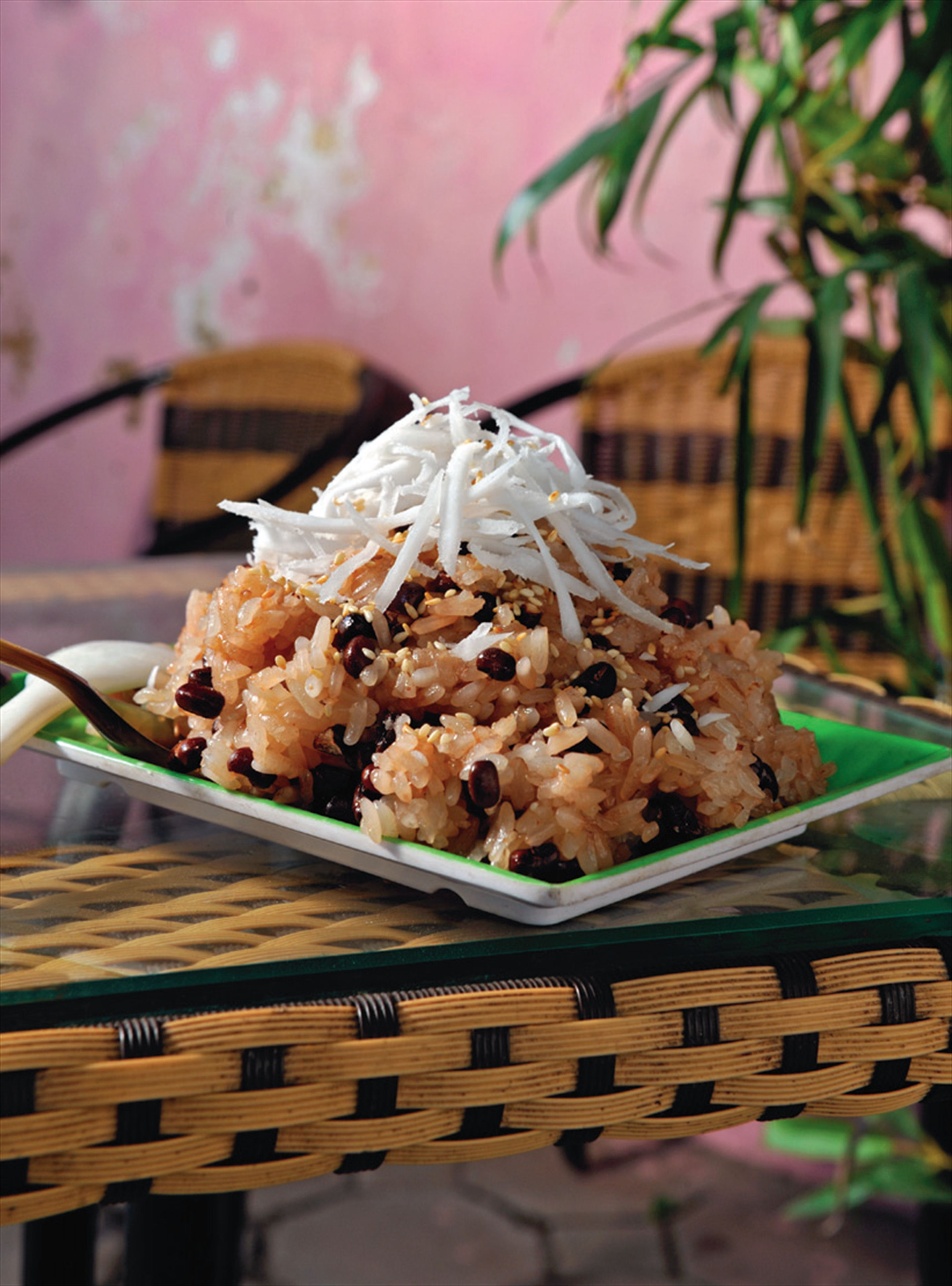 Sticky rice with red beans, coconut and sesame seeds