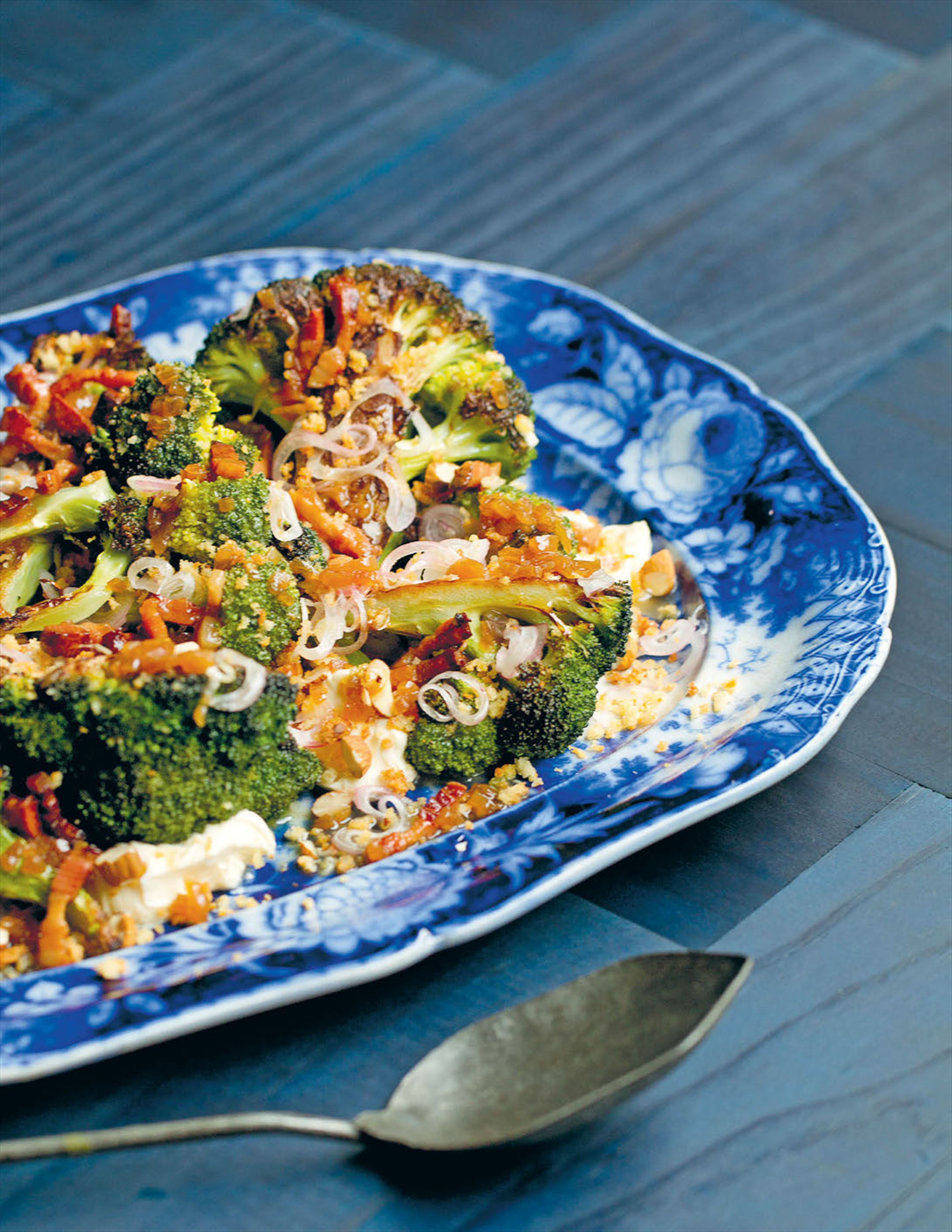 Baked broccoli with goat's curd, horseradish and bacon vinaigrette