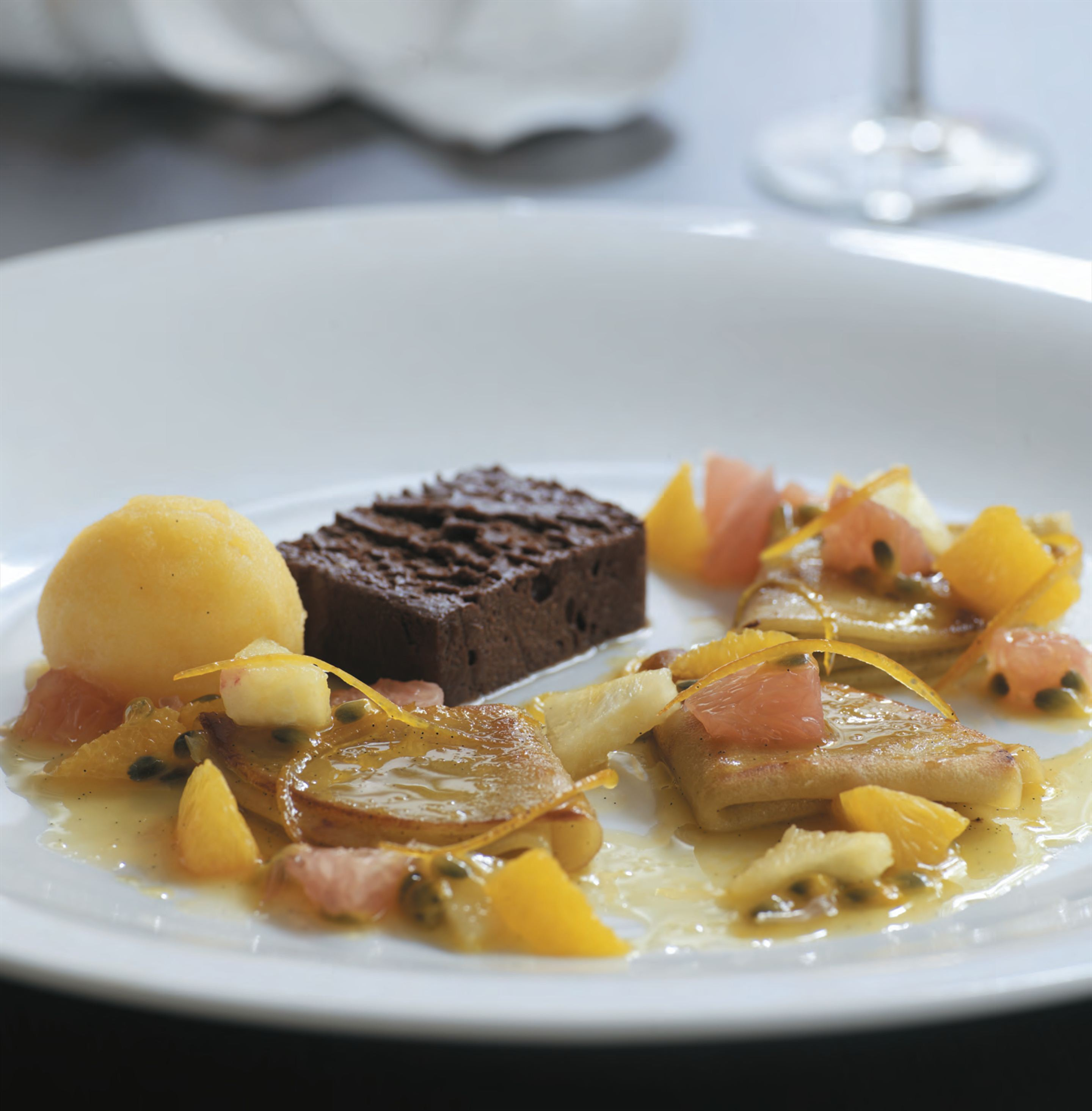 Chocolate terrine with warm passionfruit crêpes suzette and citrus salad