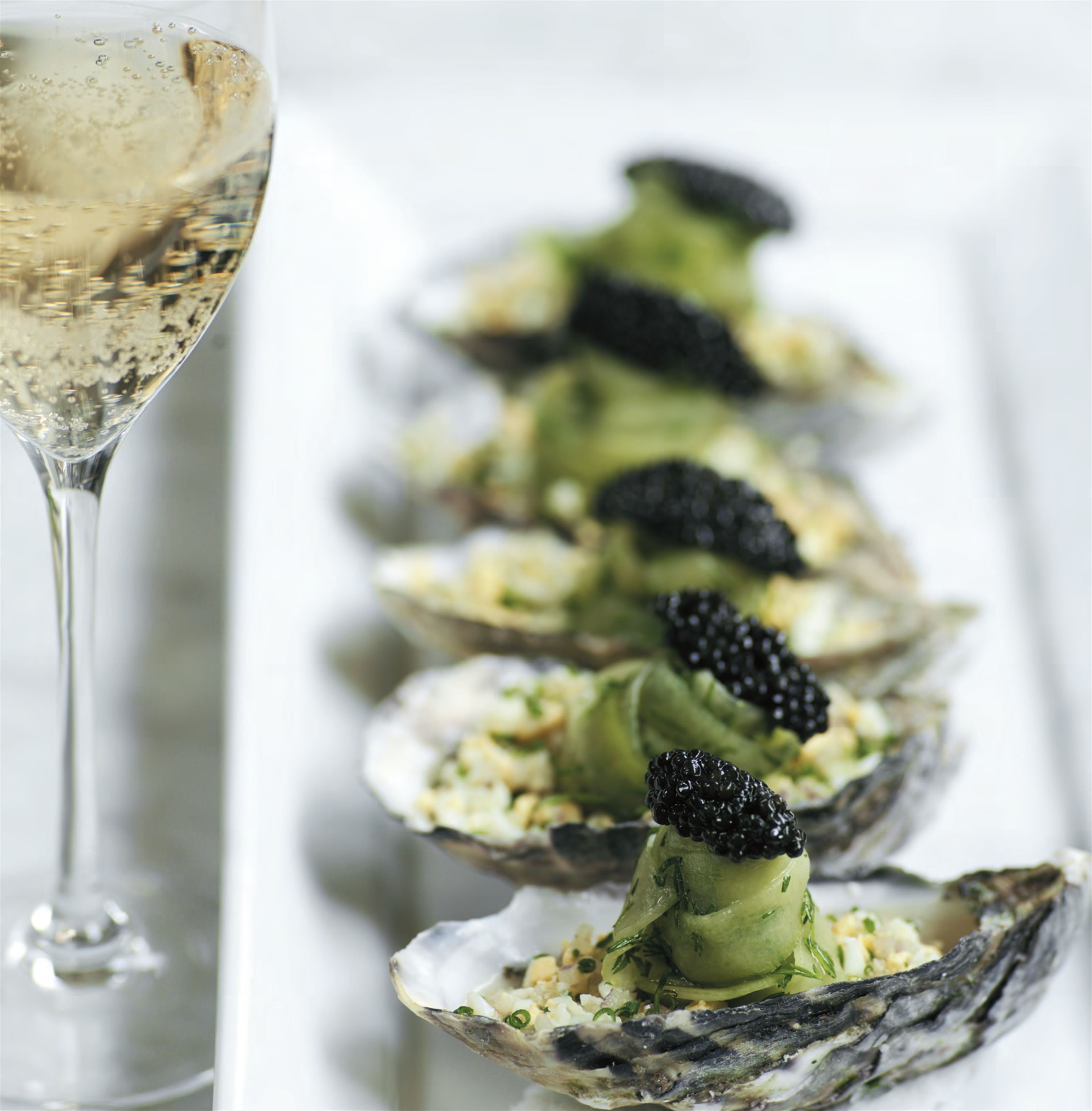 Jumbo St Helen's Pacific oysters with horseradish, pickled cucumber and Osietra caviar