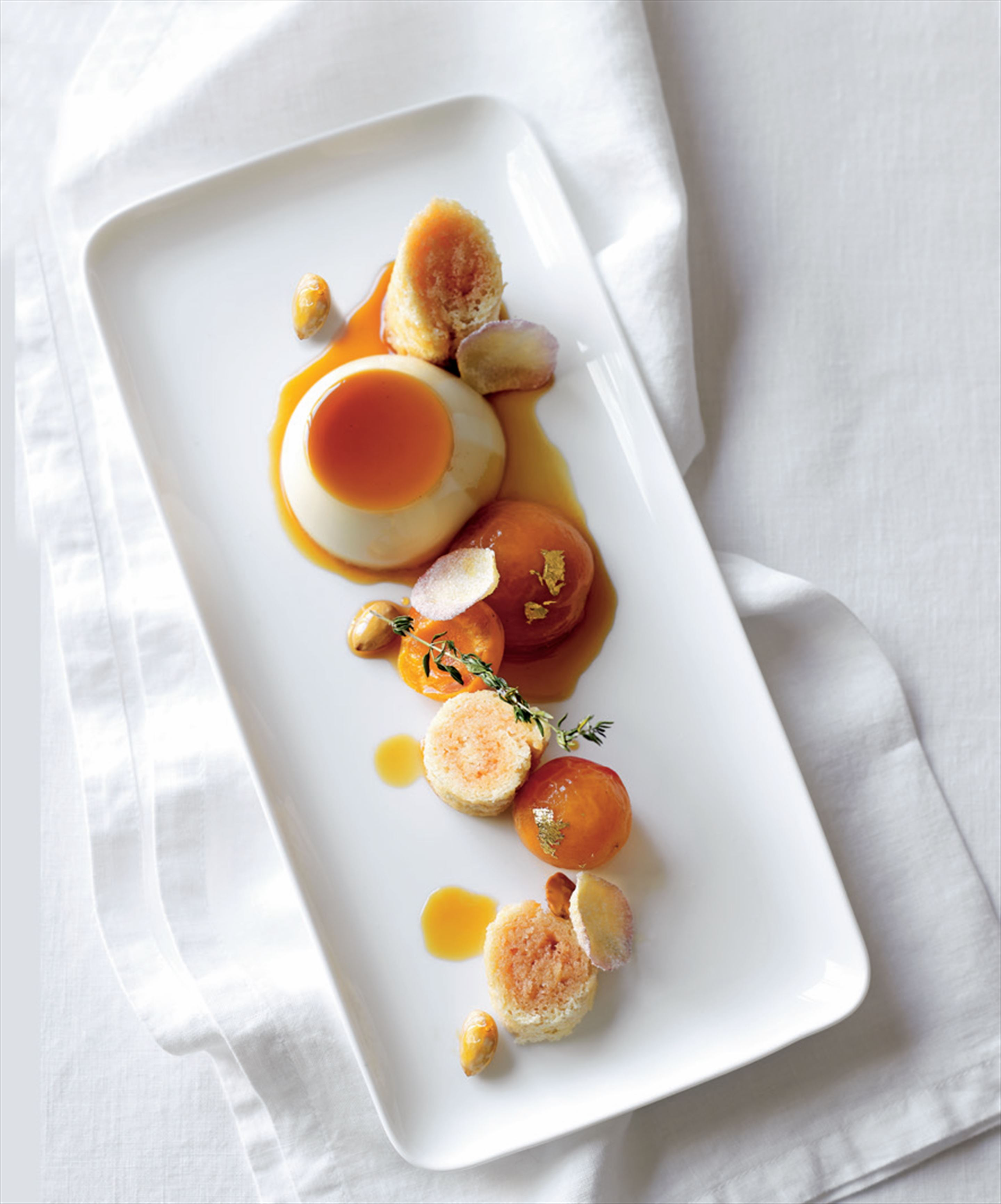 Sauternes crème caramel, thyme-roasted apricots and almond roly-poly