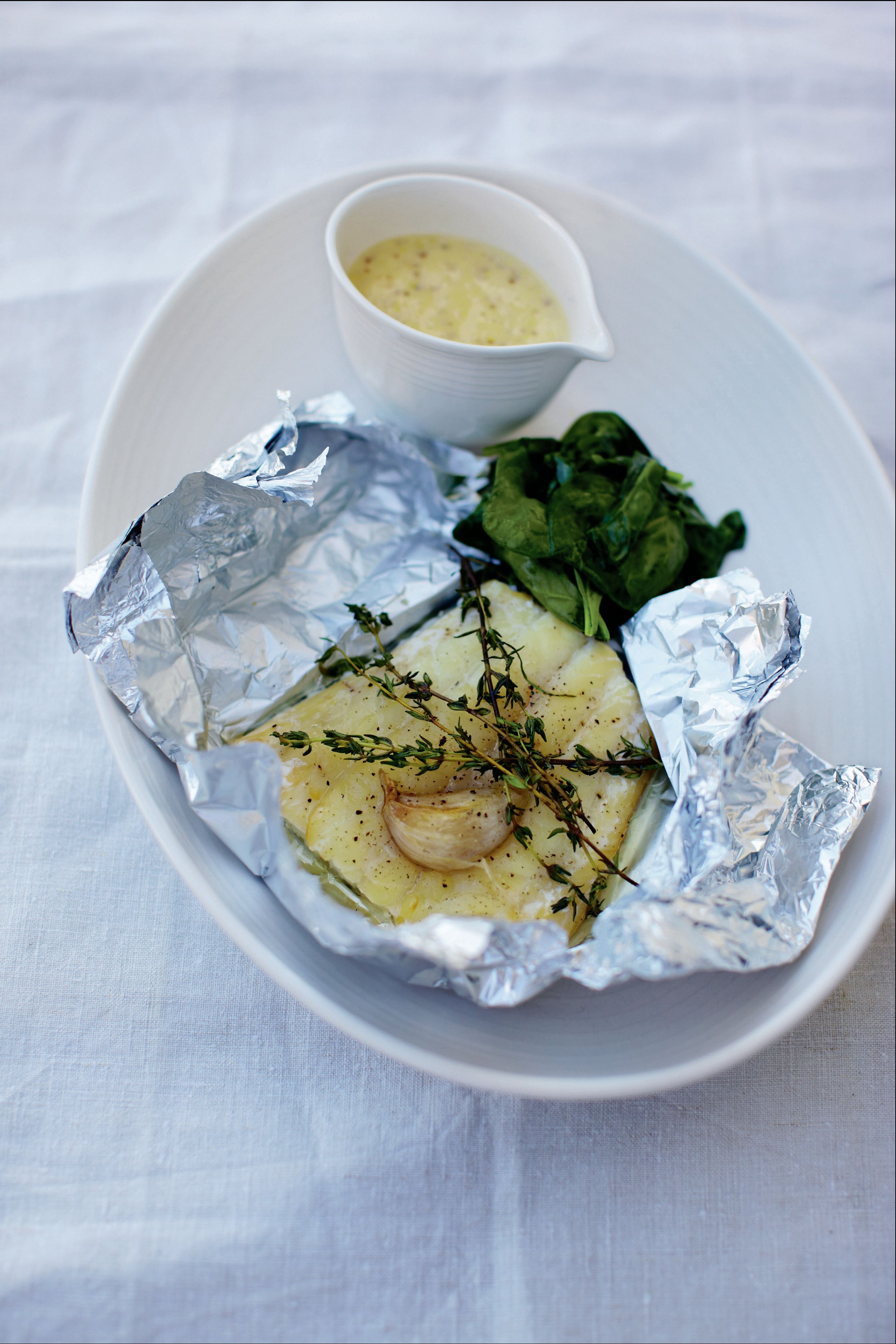 Smoked haddock with mustard sauce and sea spinach