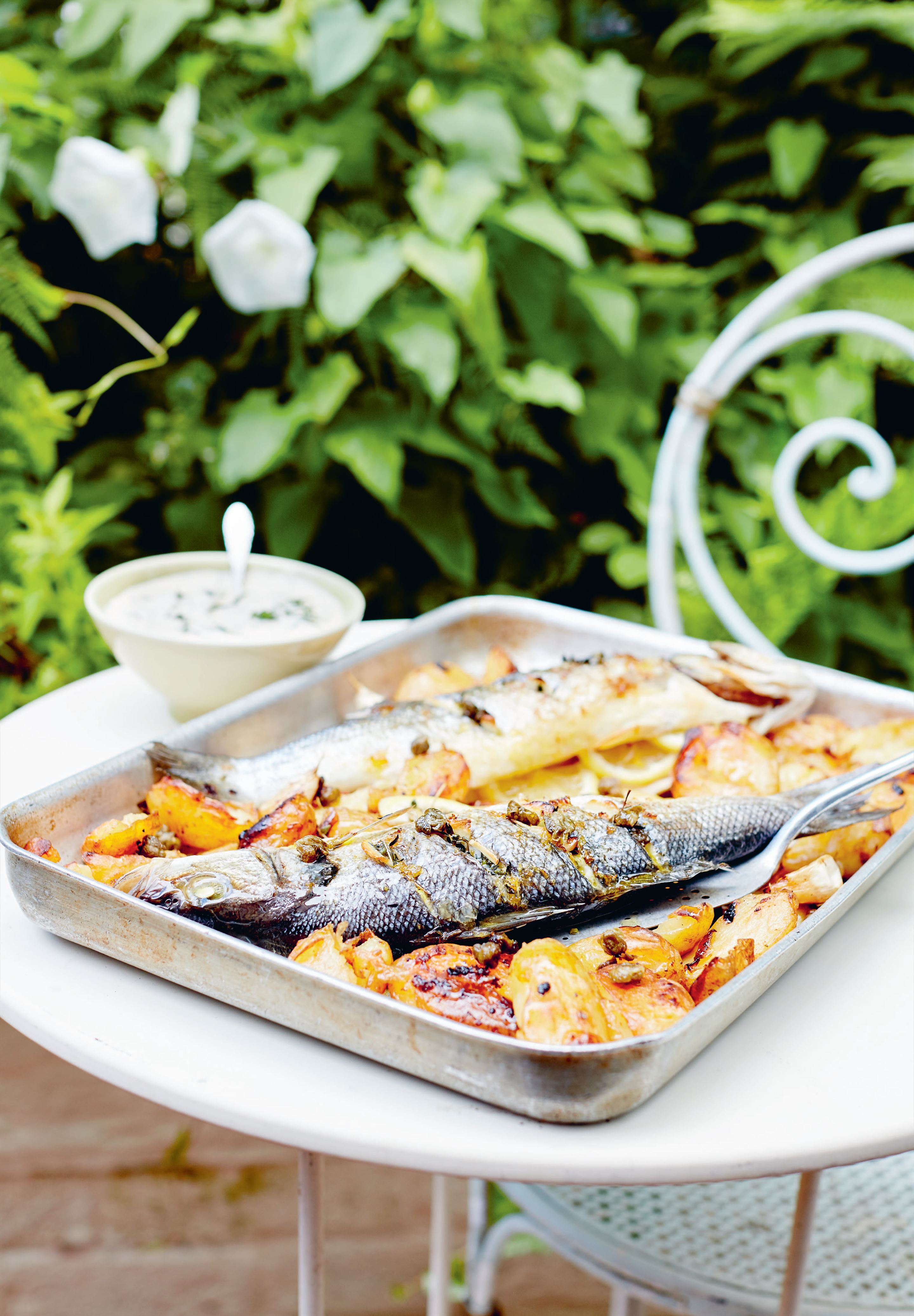 Whole baked fish with lemon and ouzo