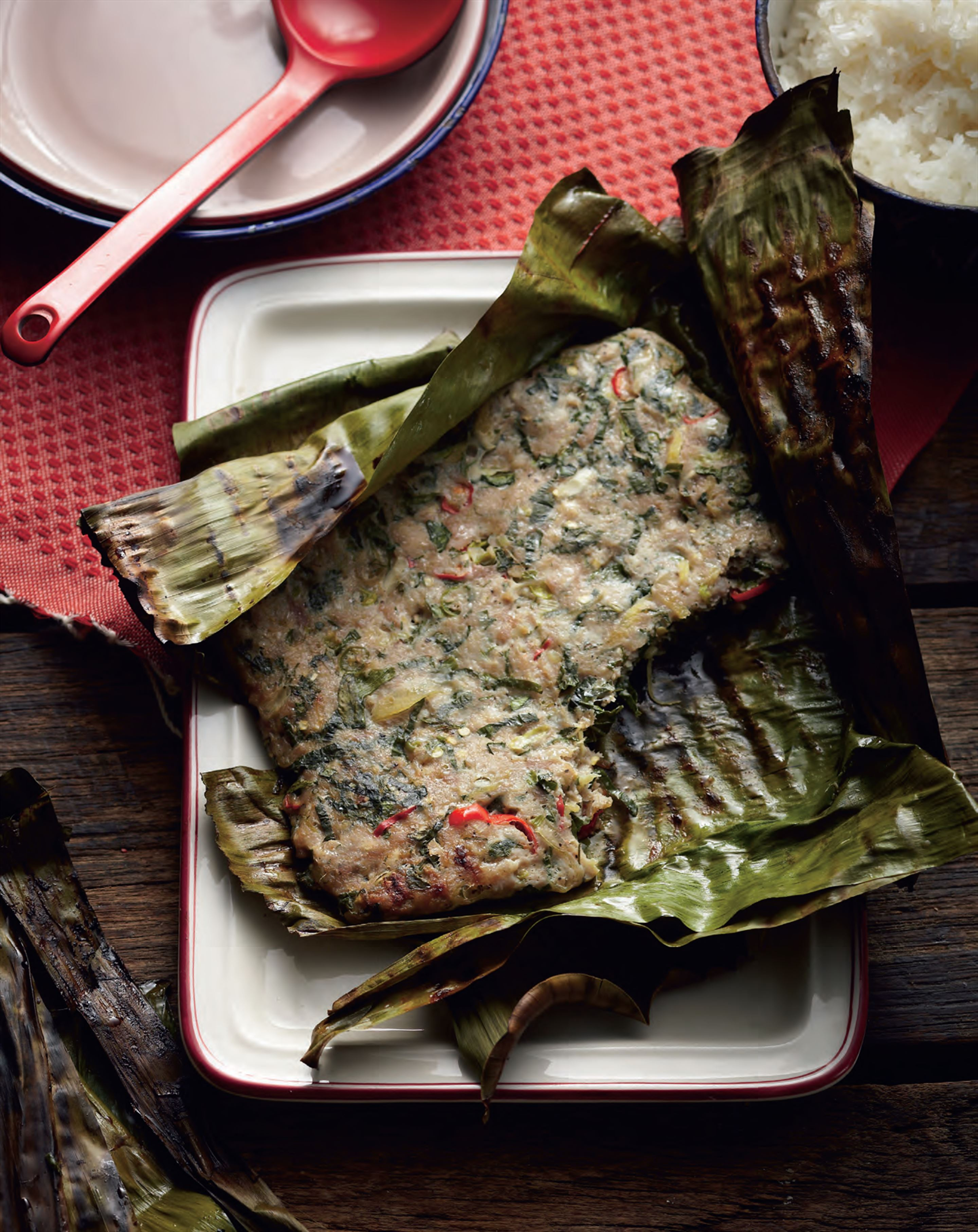 Chicken and herbs wrapped in banana leaf