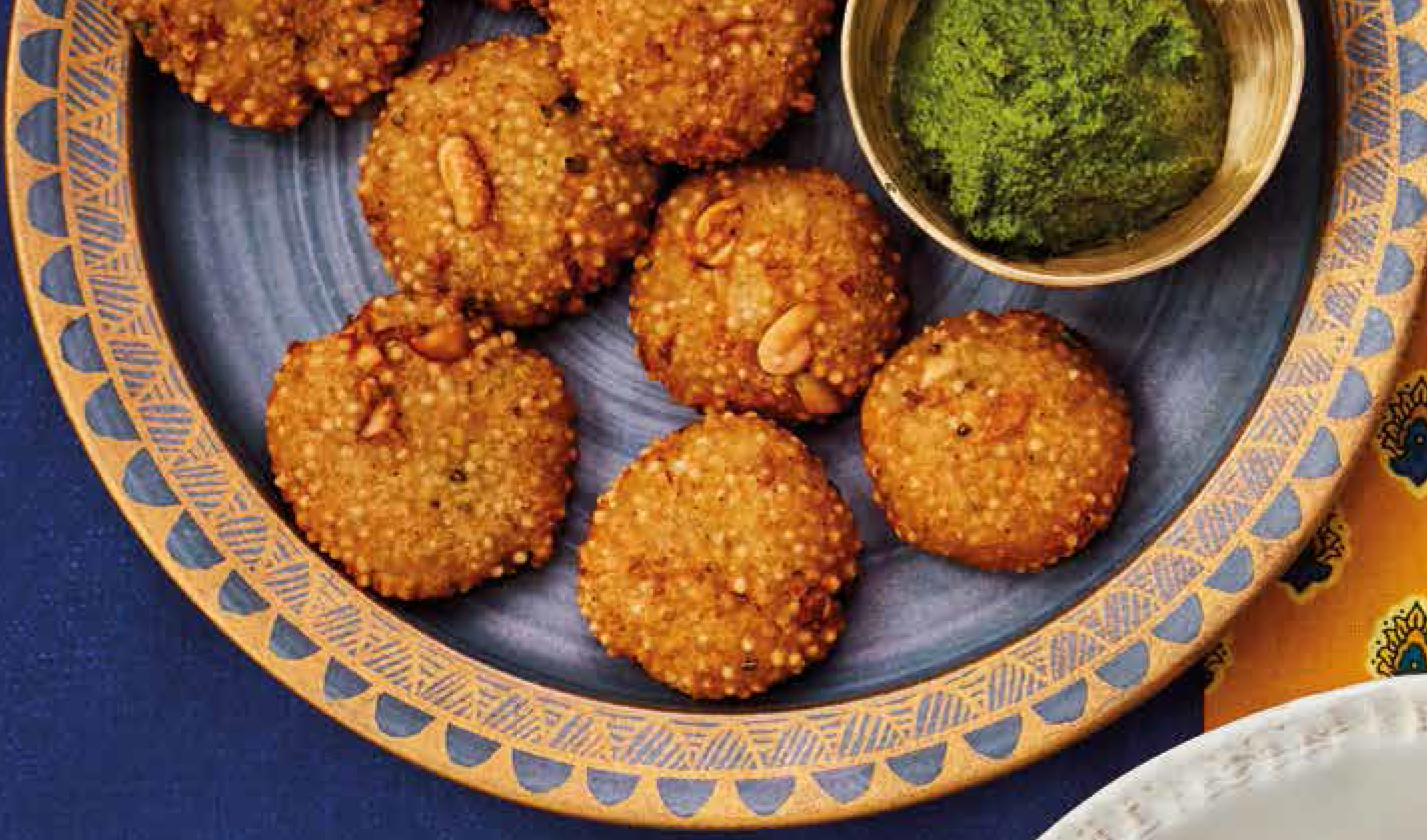 Tapioca cumin fritters with green coconut chutney