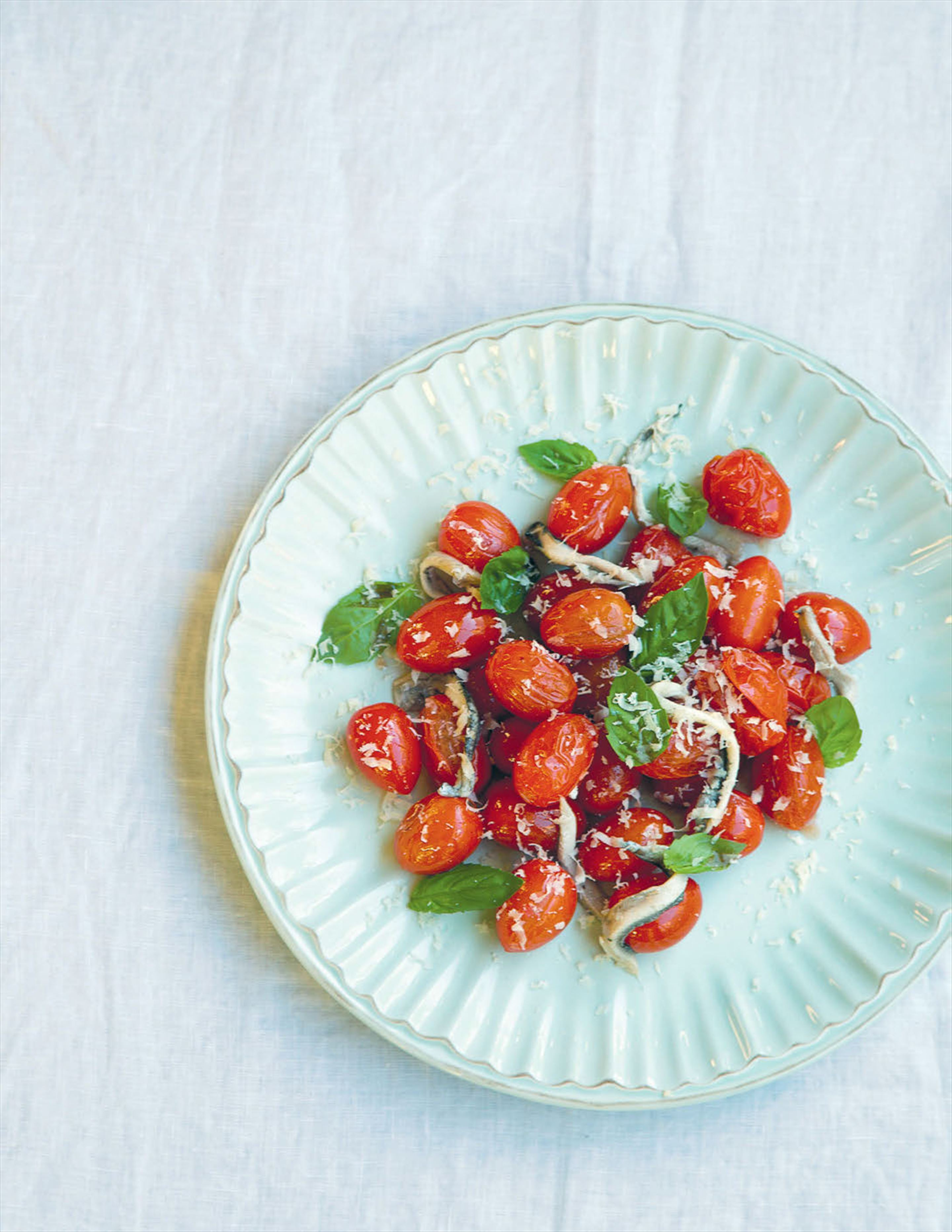 Scorched tomatoes with white anchovies and salted ricotta