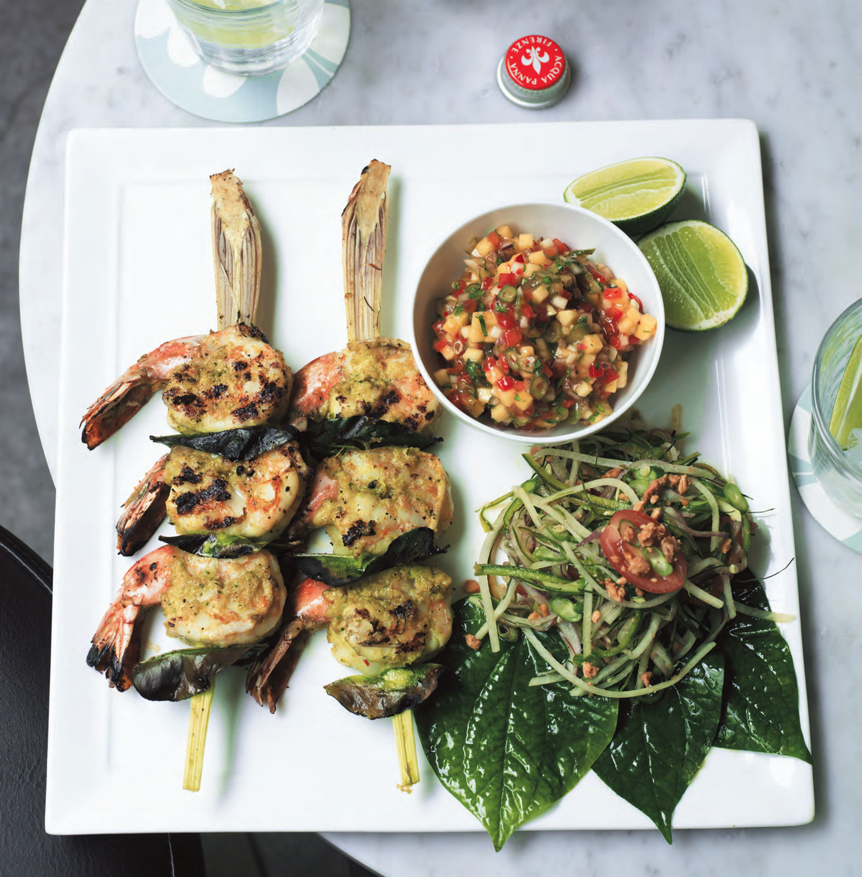 Grilled lemongrass and prawn skewers with green mango salsa