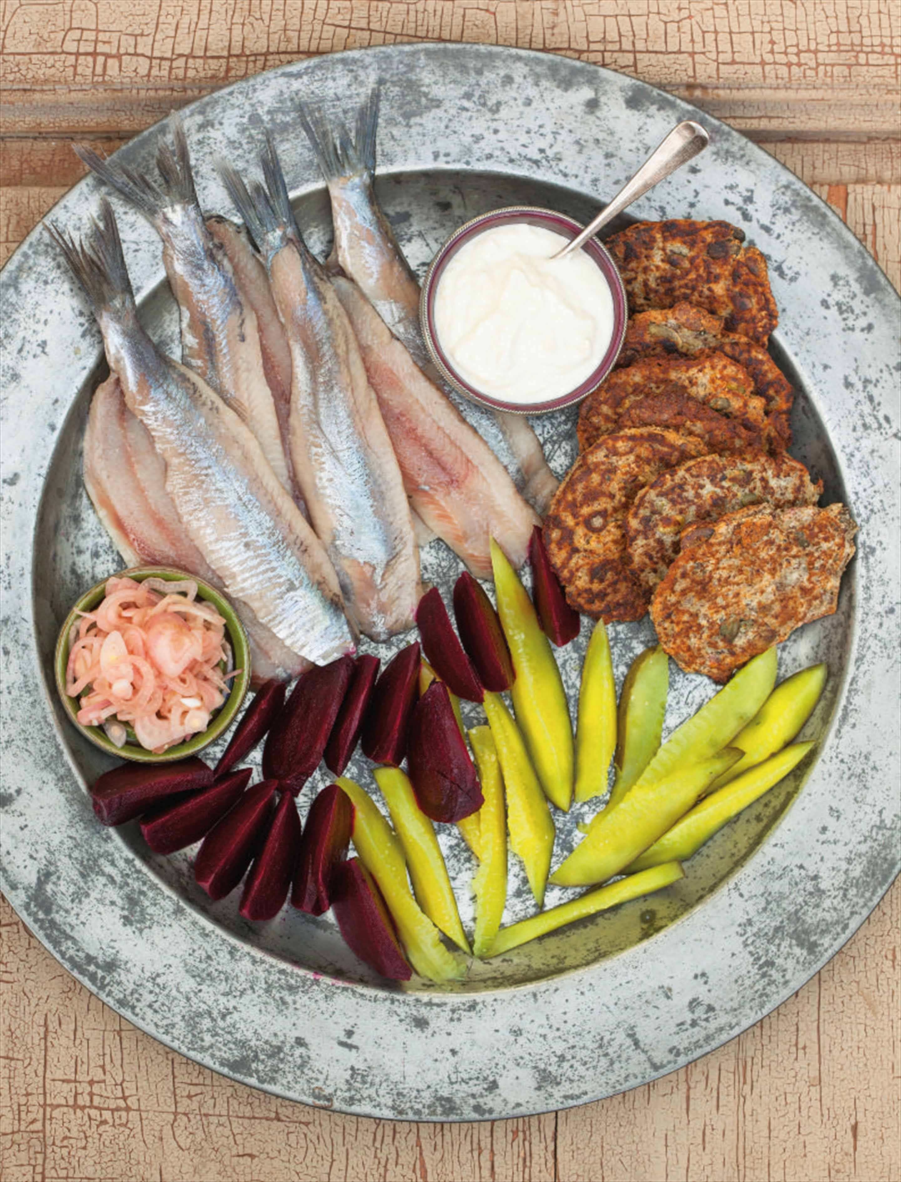 Raw herring plate with savoury buckwheat pancakes