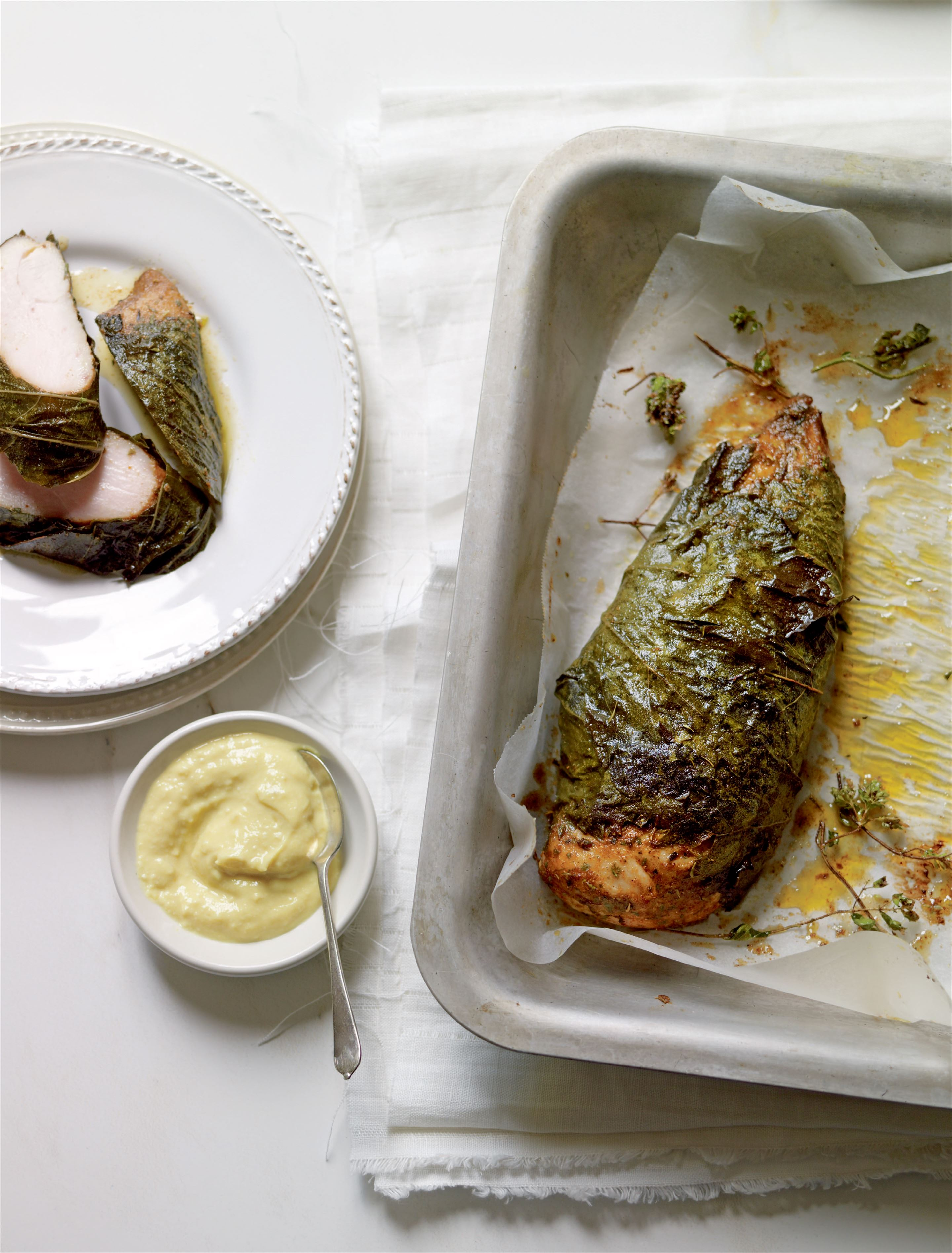 Baked chicken in crisp vine leaves