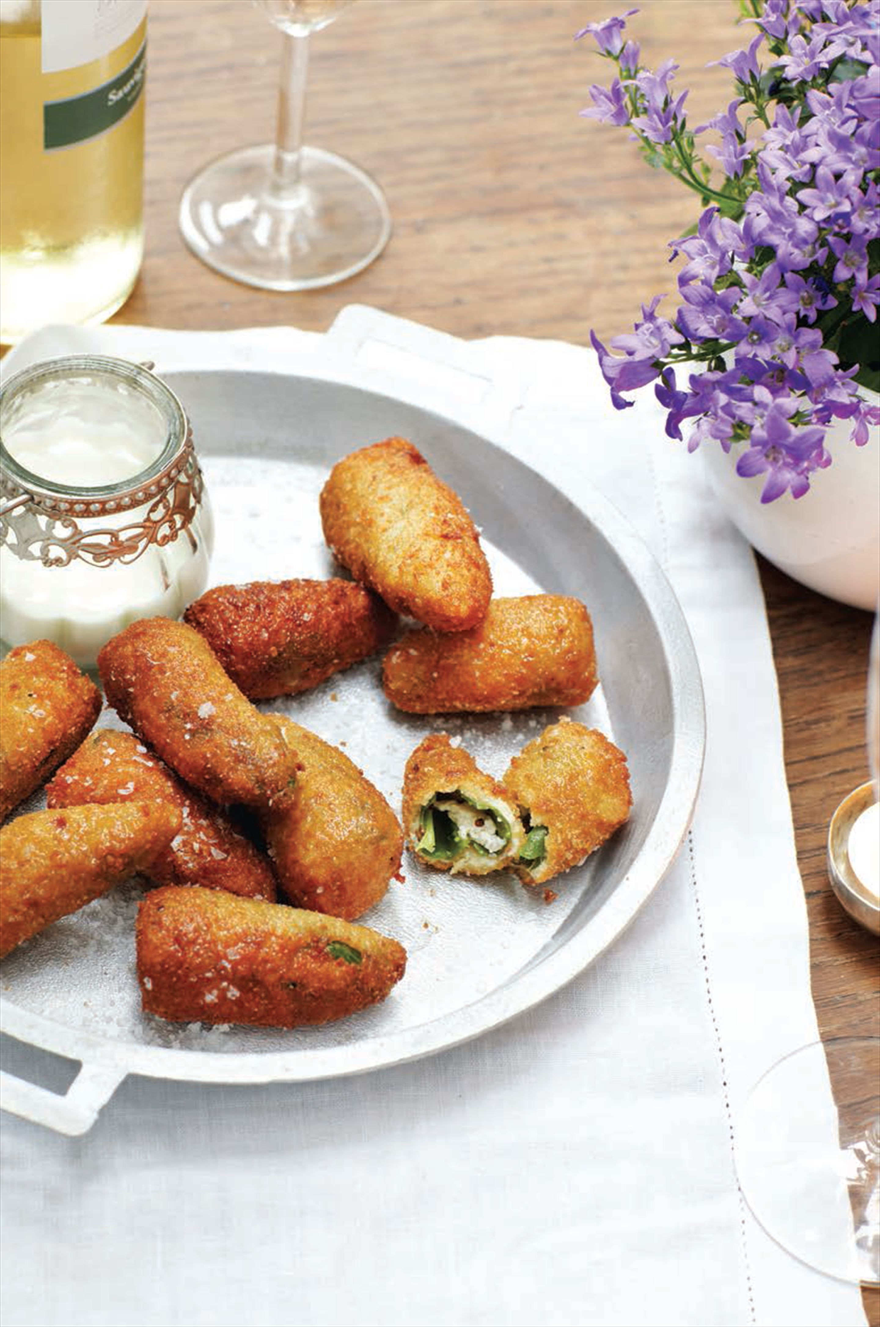 Breaded padron peppers stuffed with goat's cheese