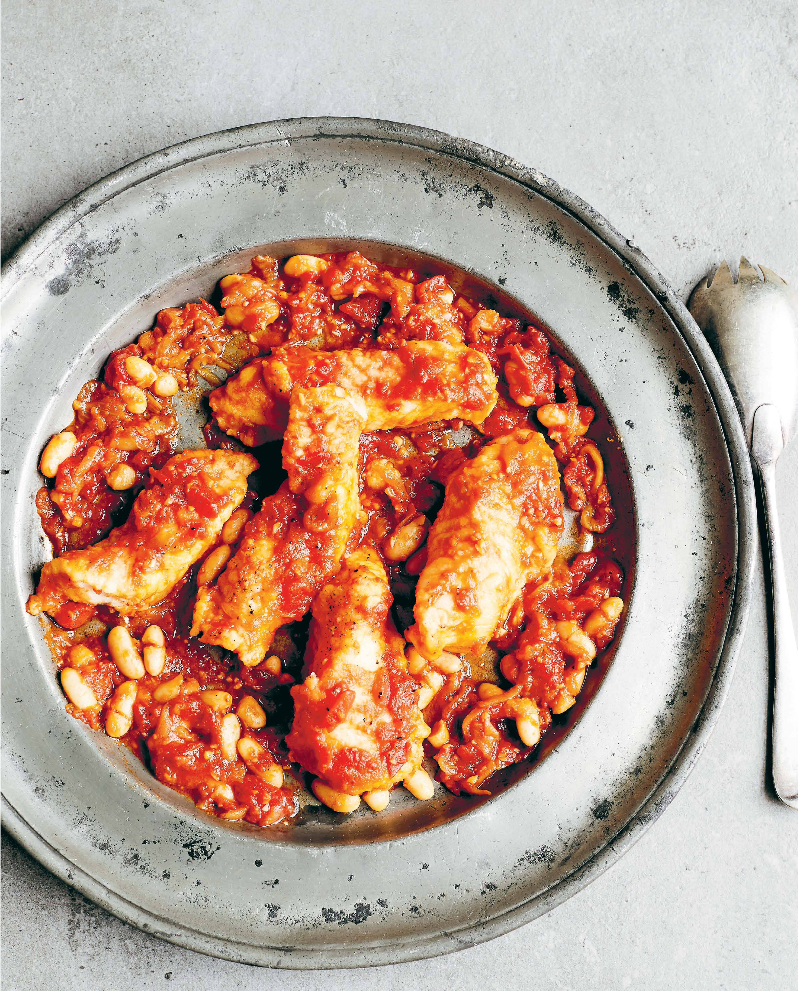 Monkfish baked with tomato and beans