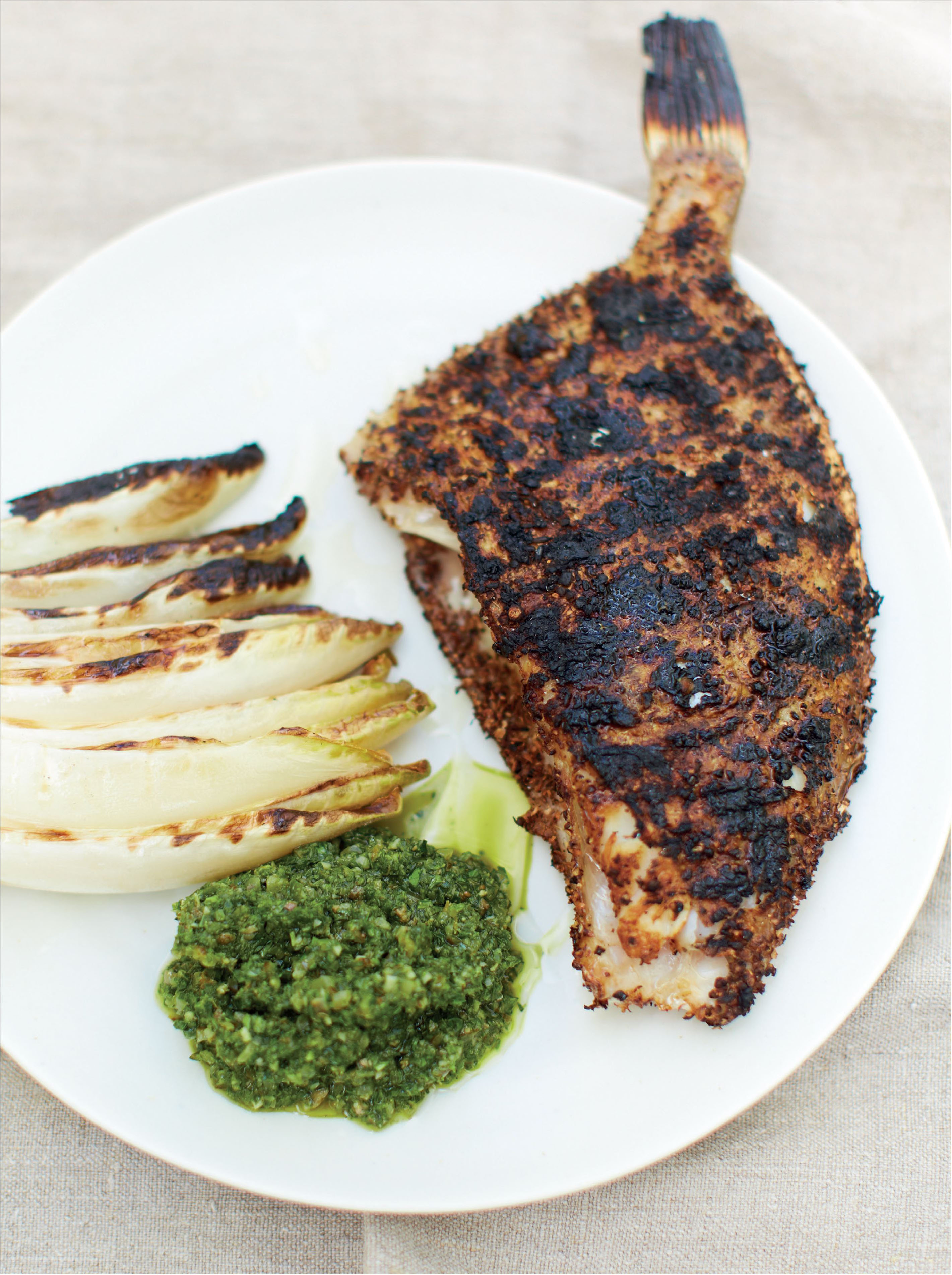 Barbecued John Dory with green sauce and chicory