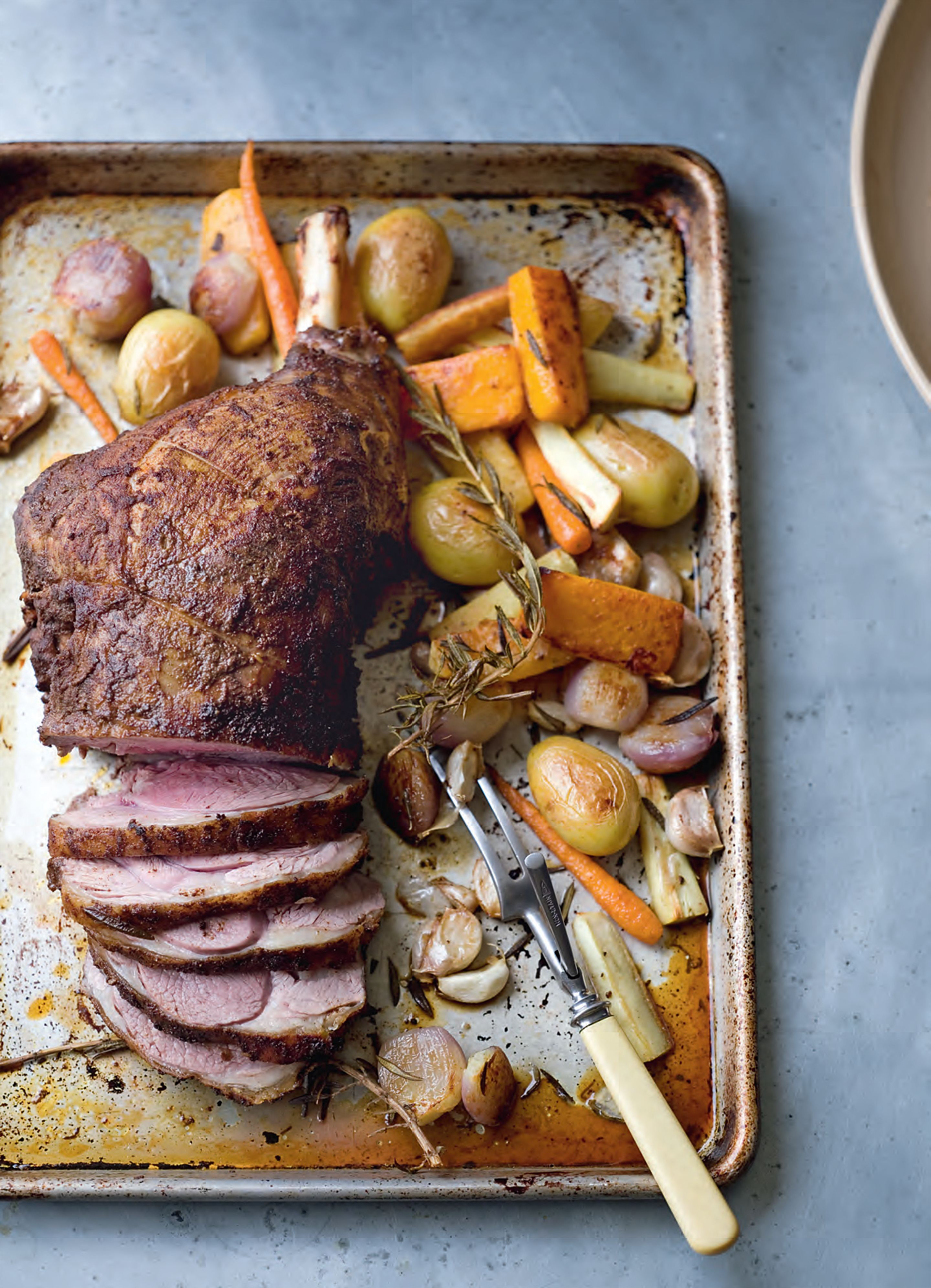 Roast leg of lamb with baharat and root vegetables