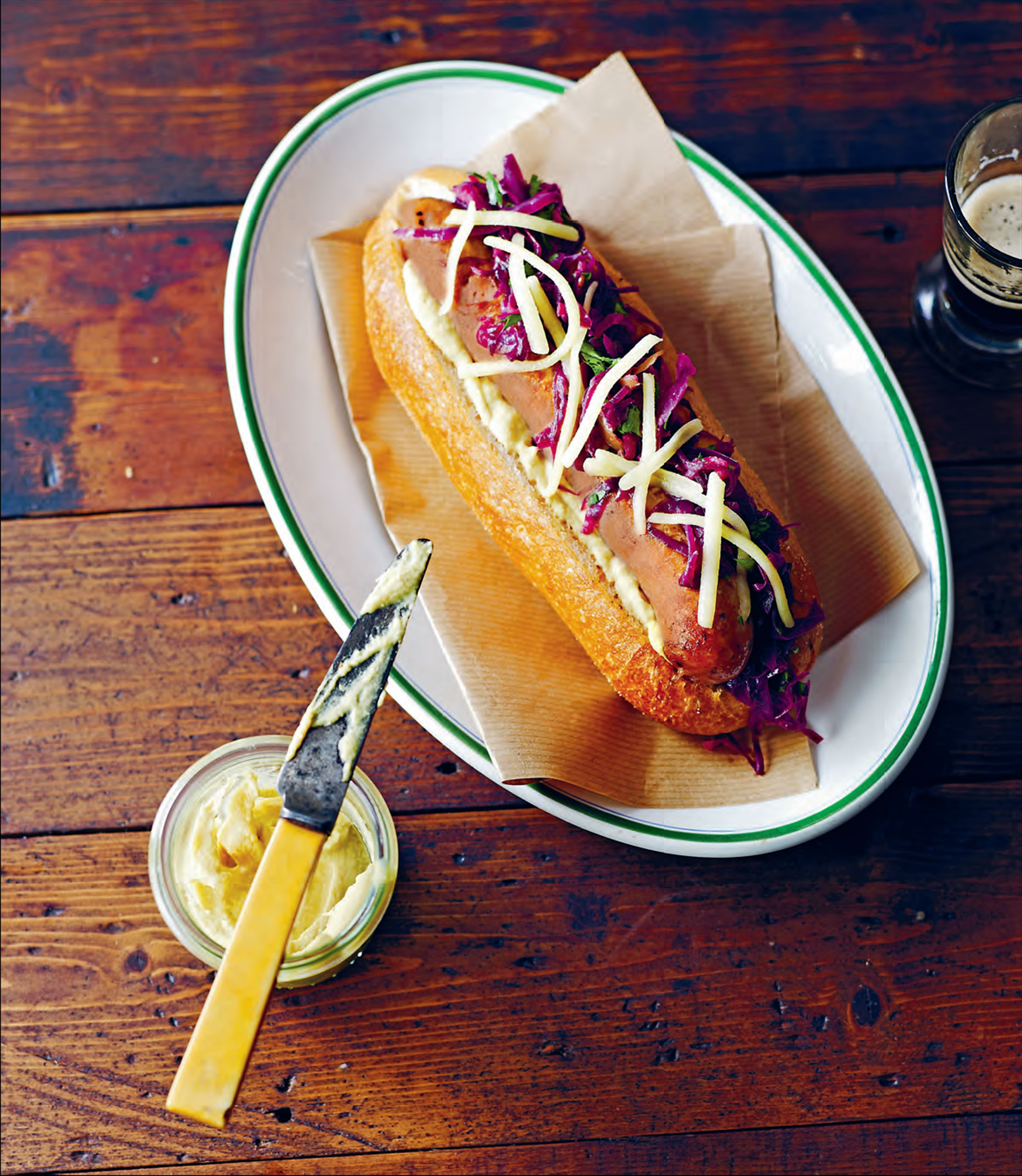 Gourmet hotdogs with braised red cabbage and apple