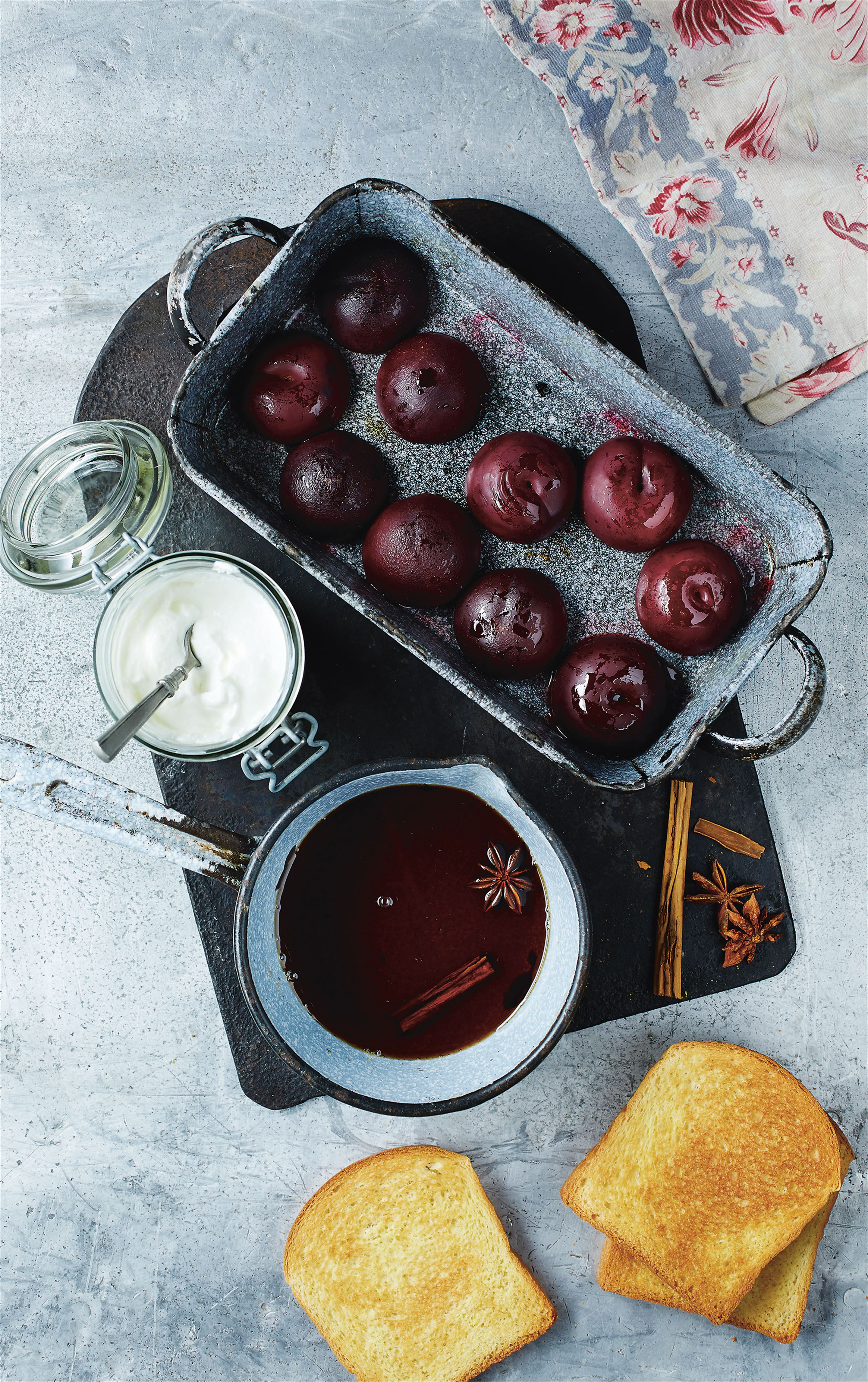 Spiced plums with yoghurt on toasted brioche