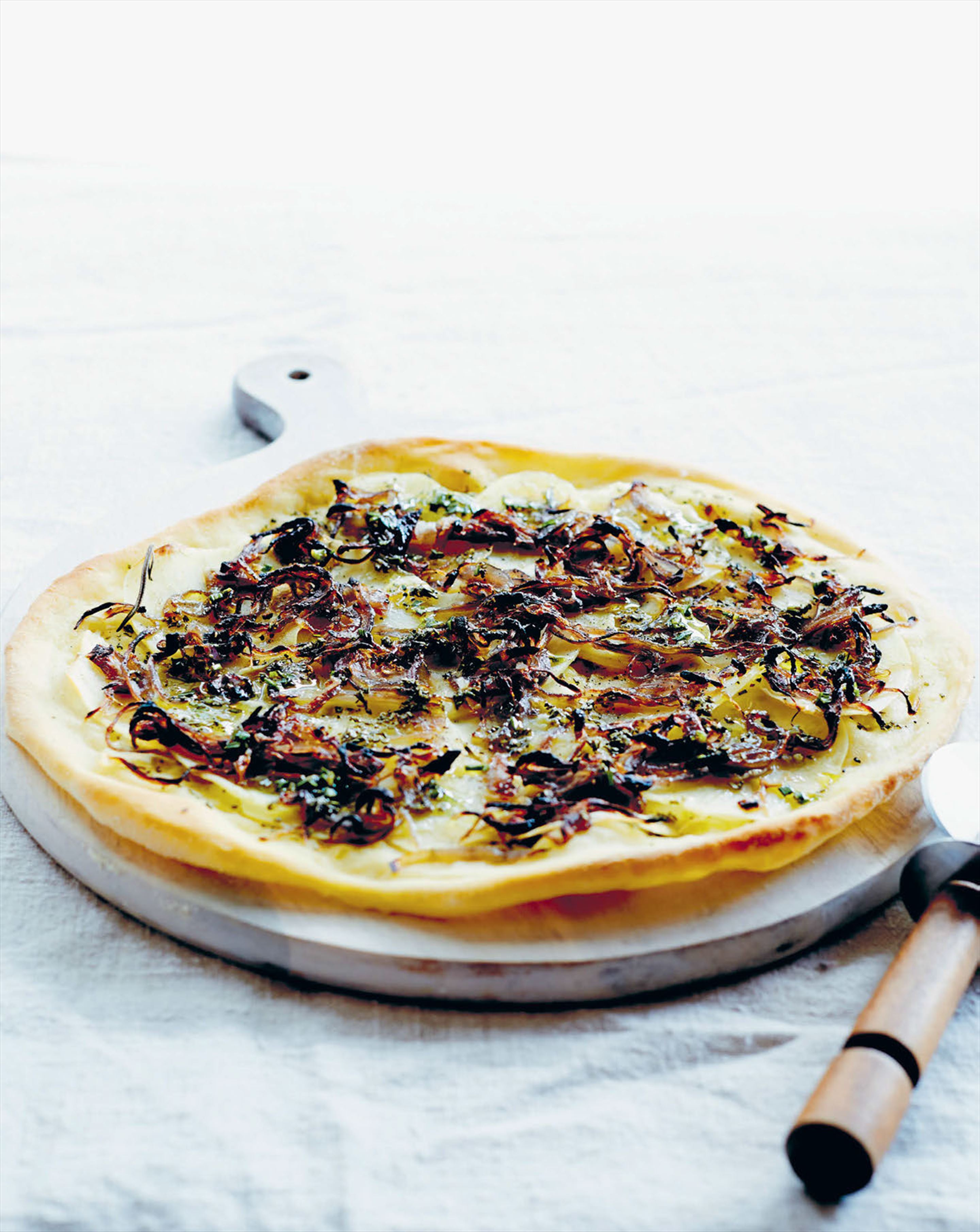 Potato, caramelised onions and rosemary oil pizza