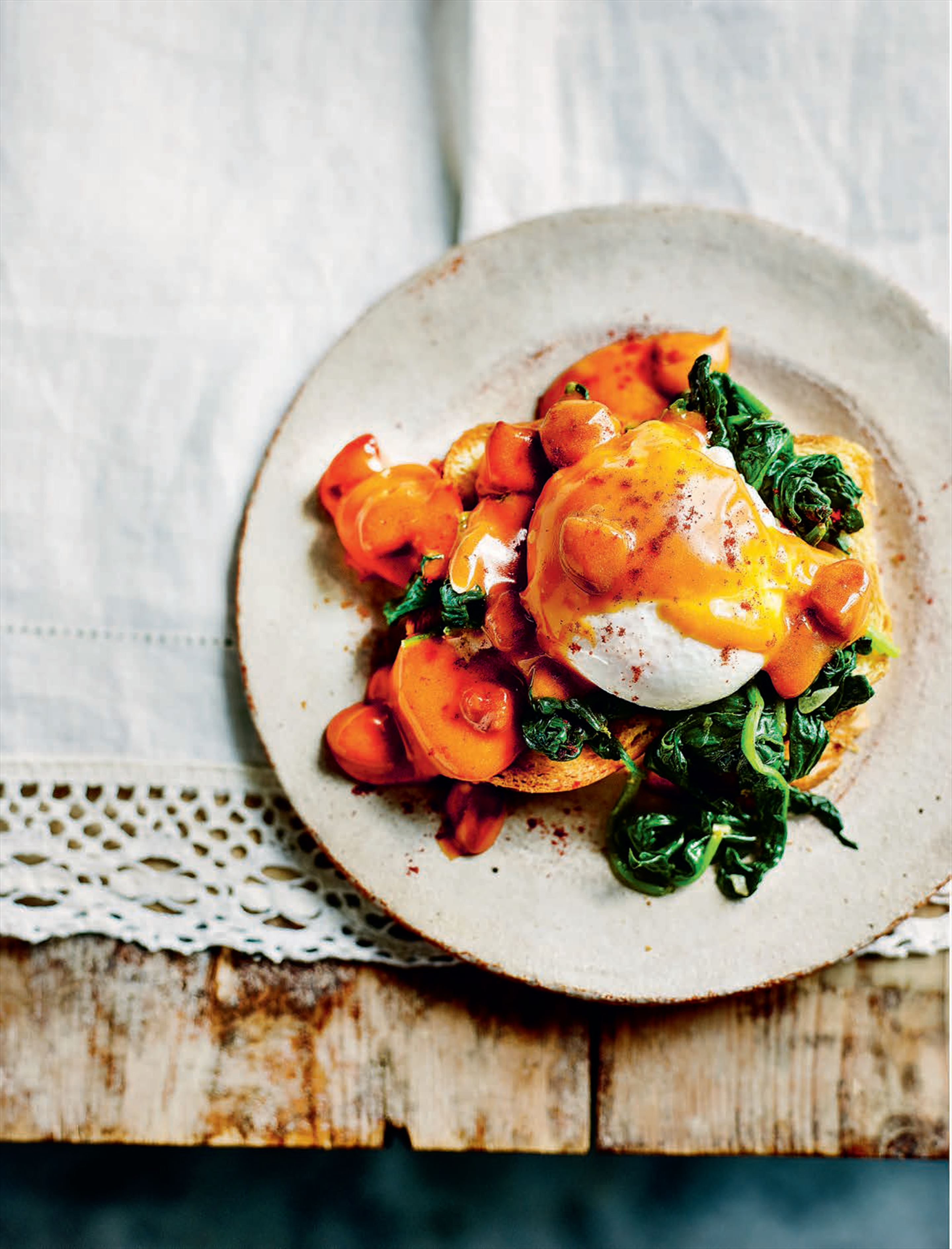 Eggs benedict with spinach and chorizo hollandaise