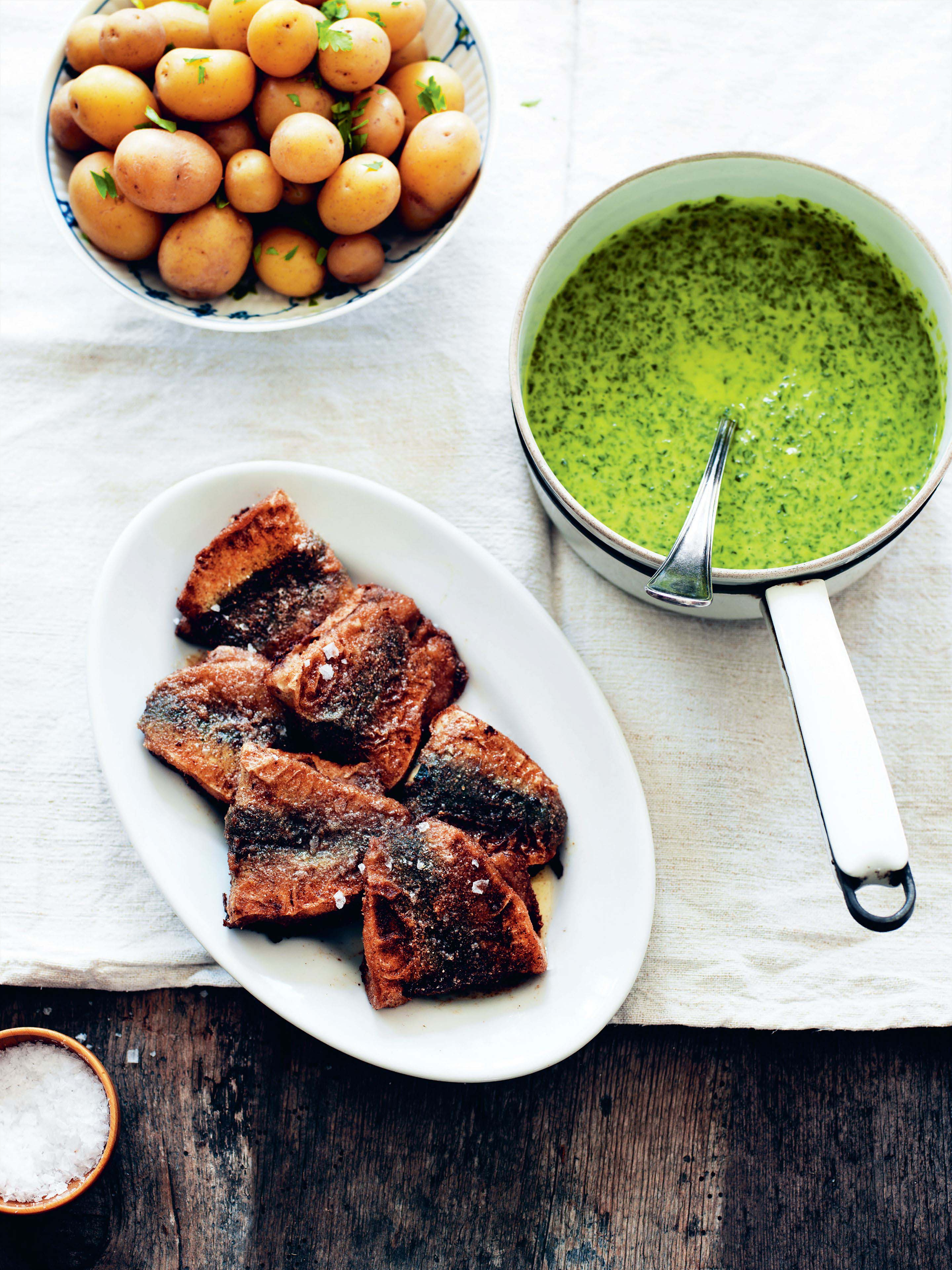 Pan-fried herrings with new potatoes and parsley sauce