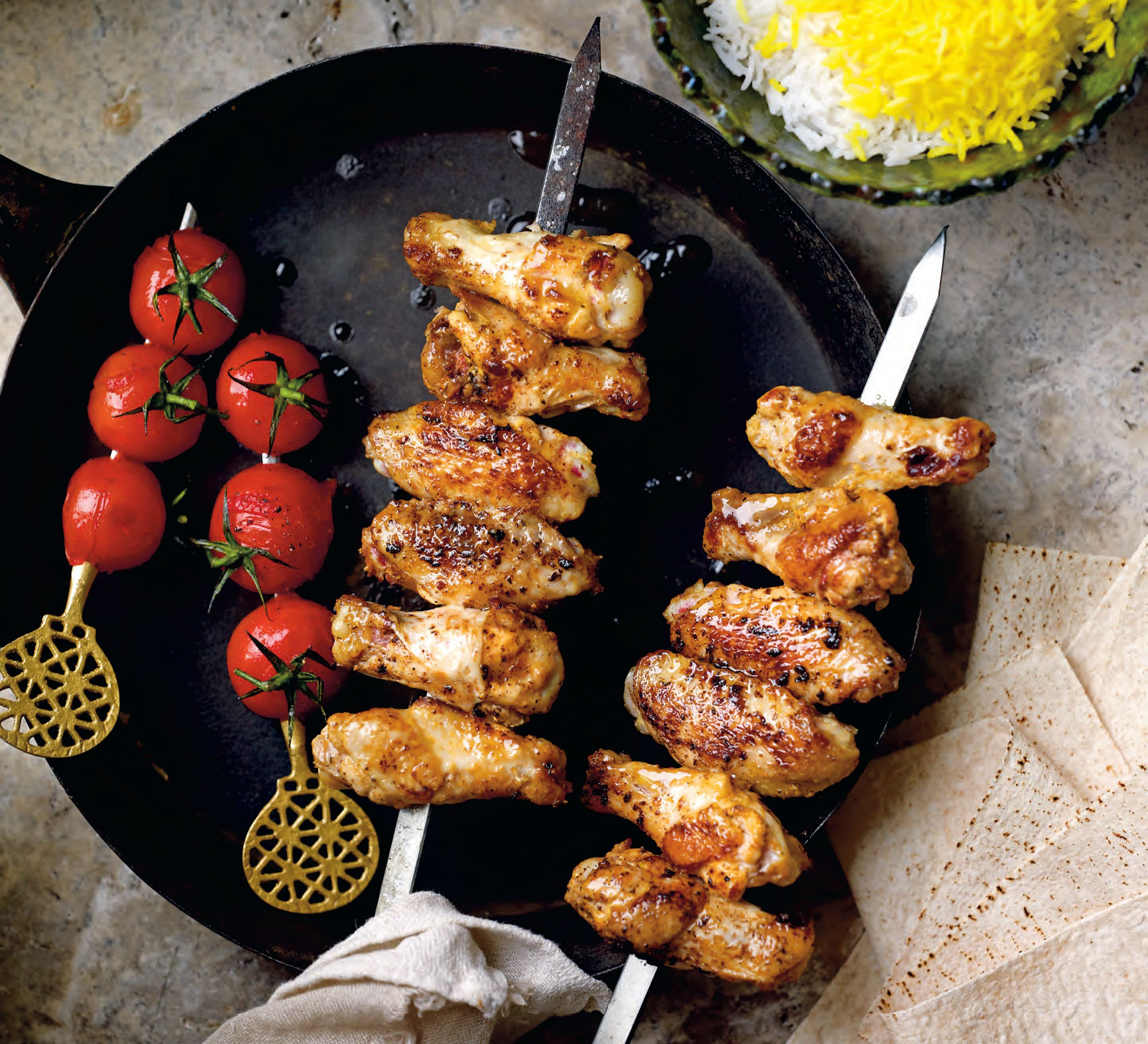 Marinated chicken wing kebabs with skewered tomatoes