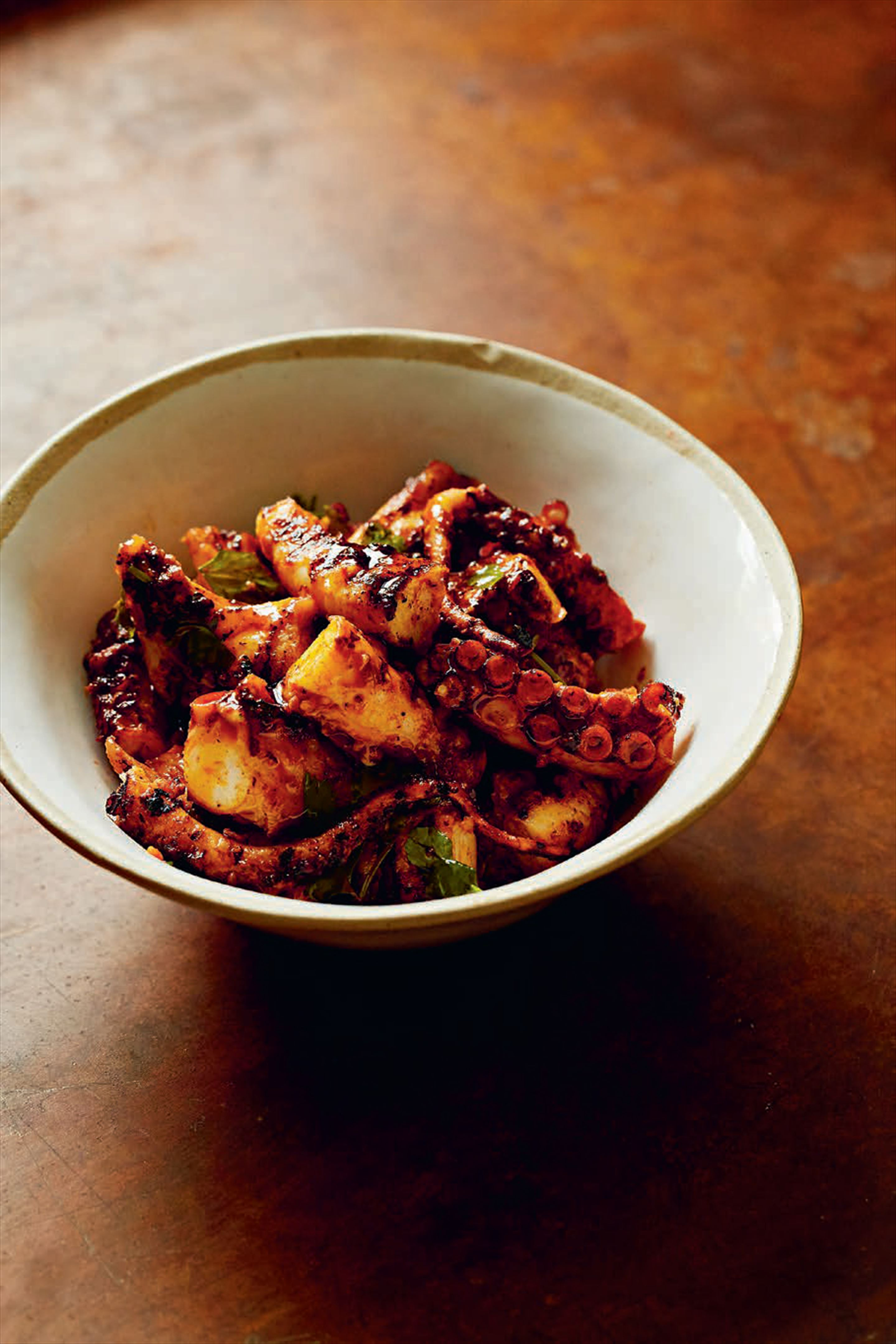 Roasted octopus with smoked paprika, parsley & lemon